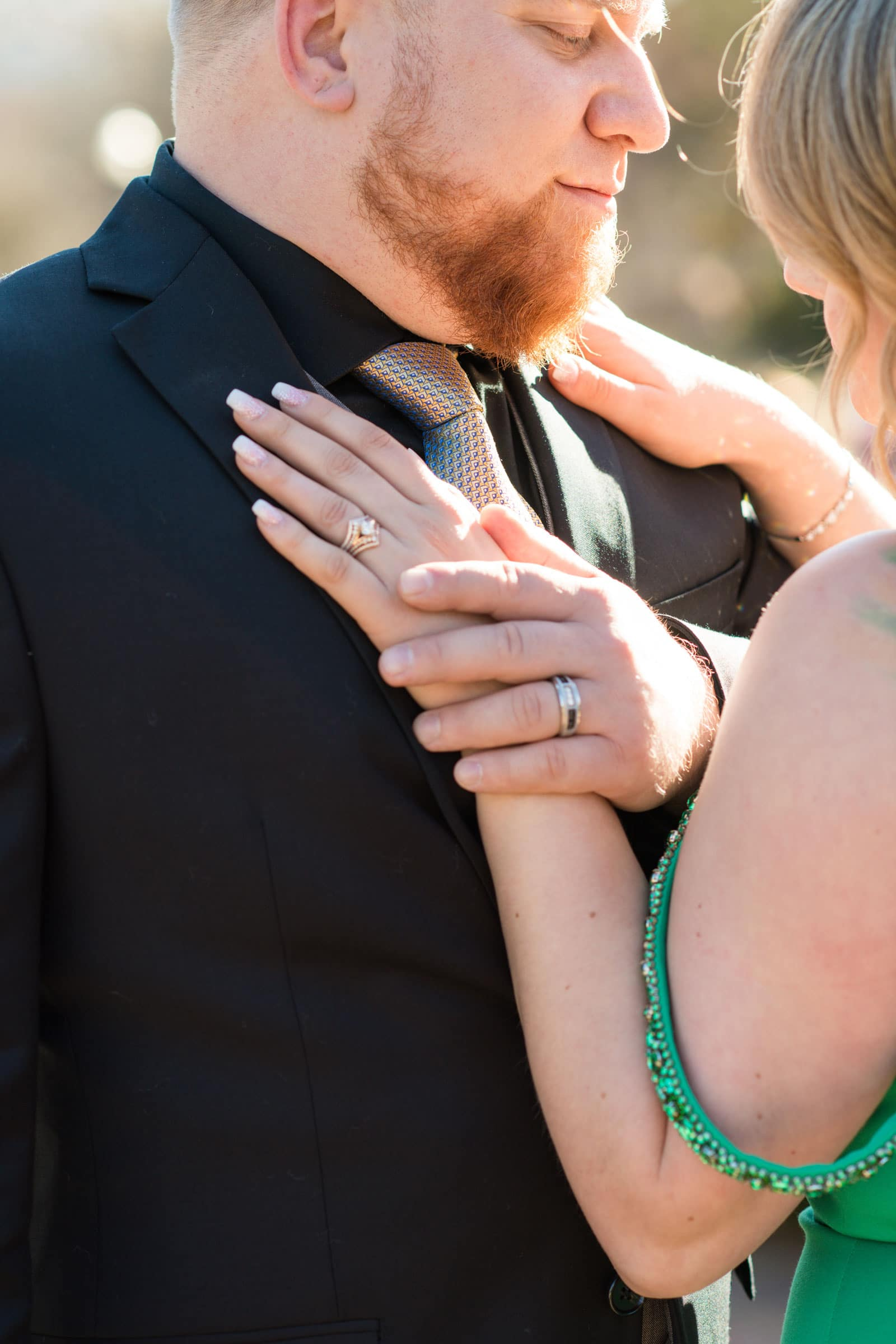 husband holds wife's hand on chest
