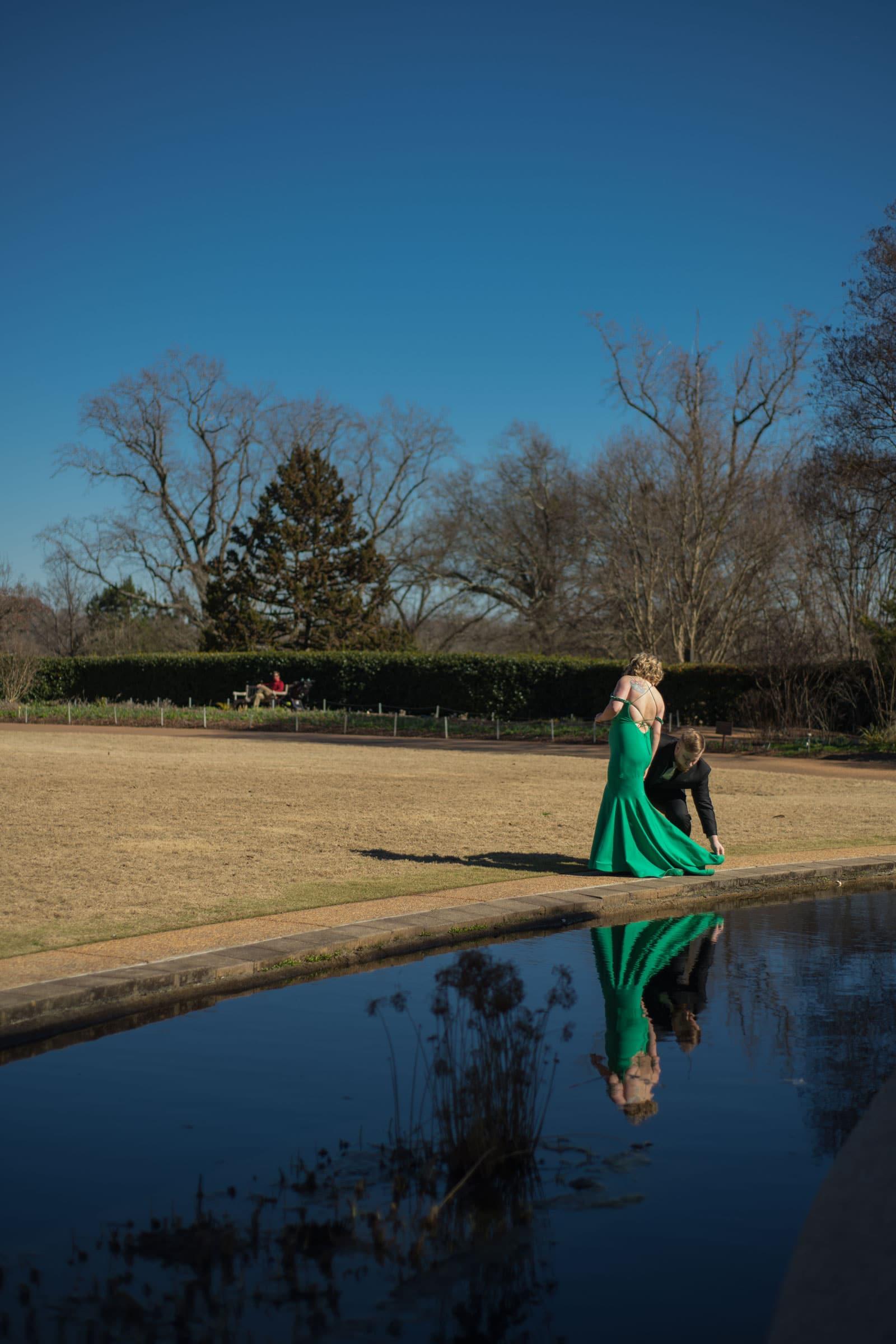married couple walks near pond in Atlanta Botanical Gardens