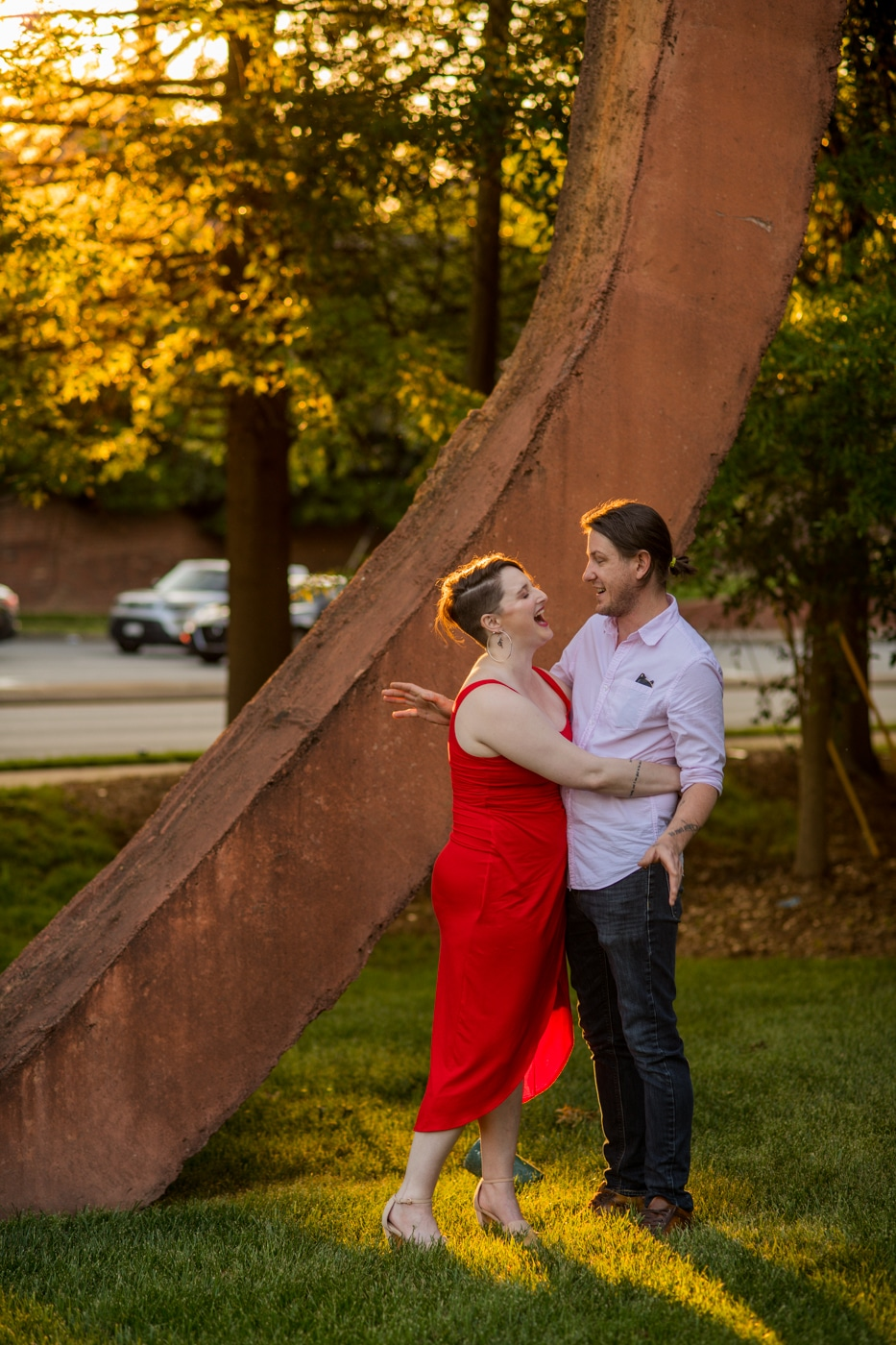 couple laughs together during Charlotte NC engagement photos