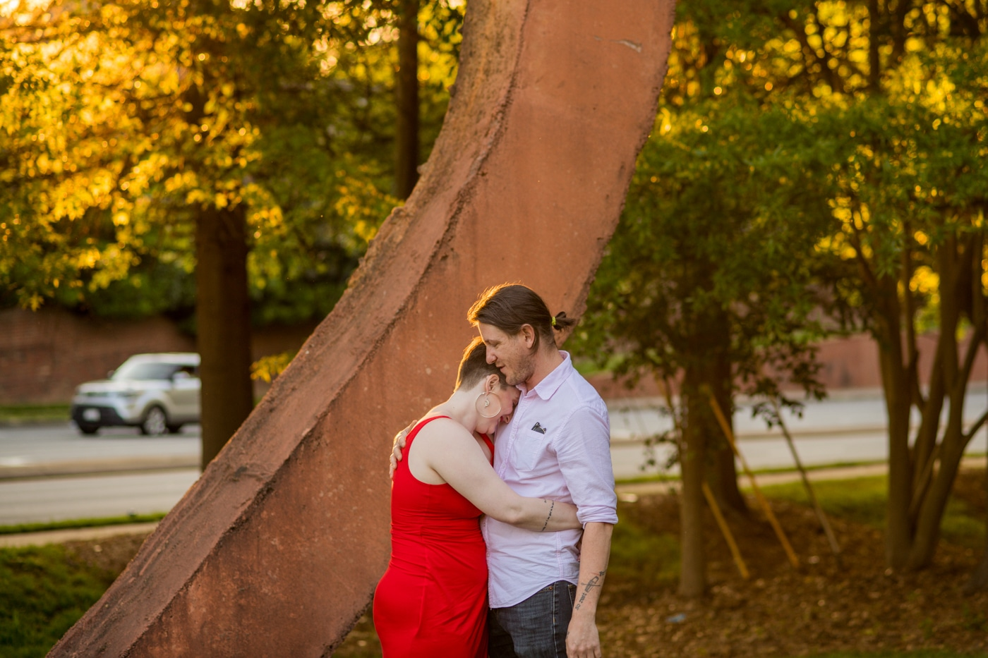 bride hugs groom with head on his shoulders during NC engagement photos