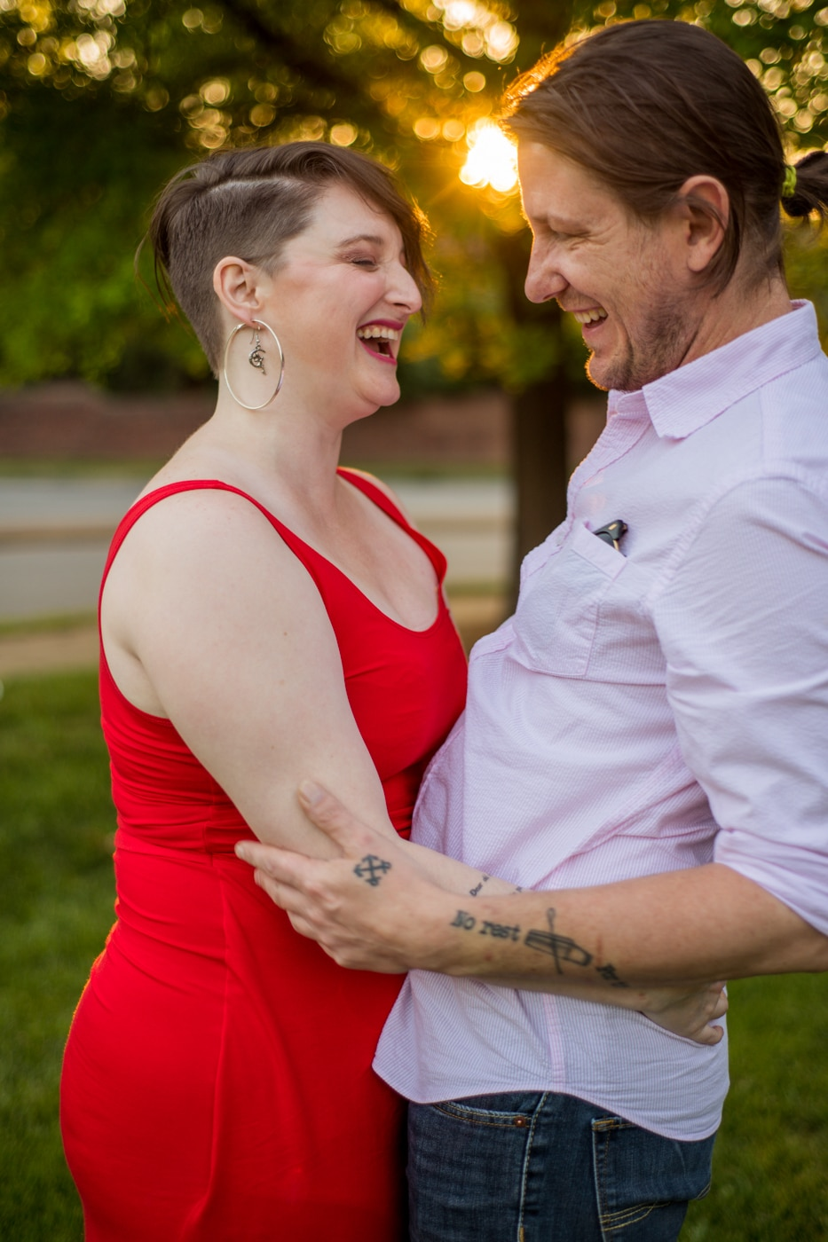 bride and groom laugh together during Charlotte NC engagement photos