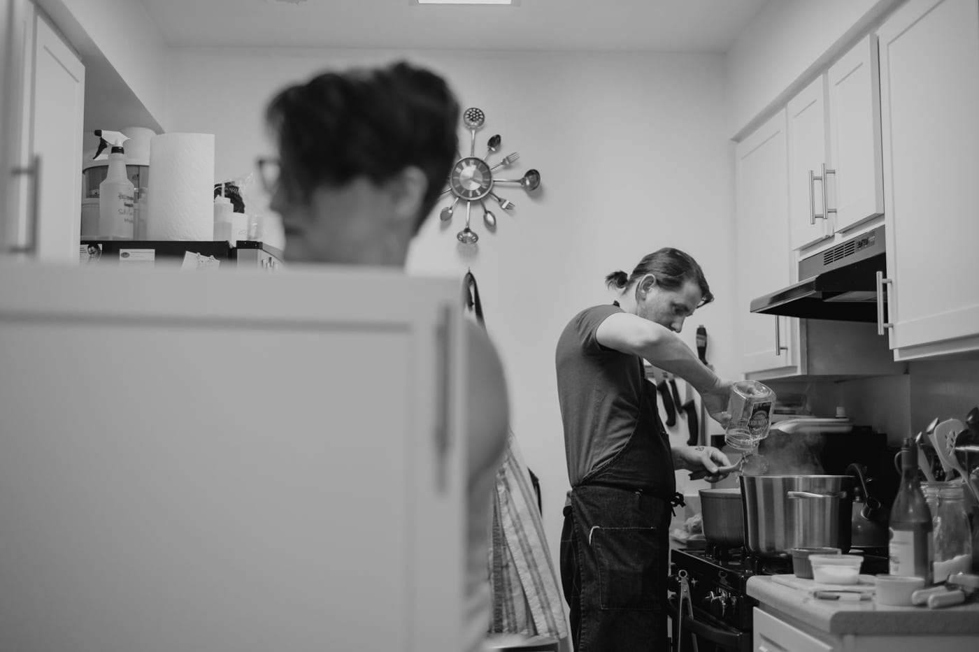 Charlotte in-home engagement session with couple cooking