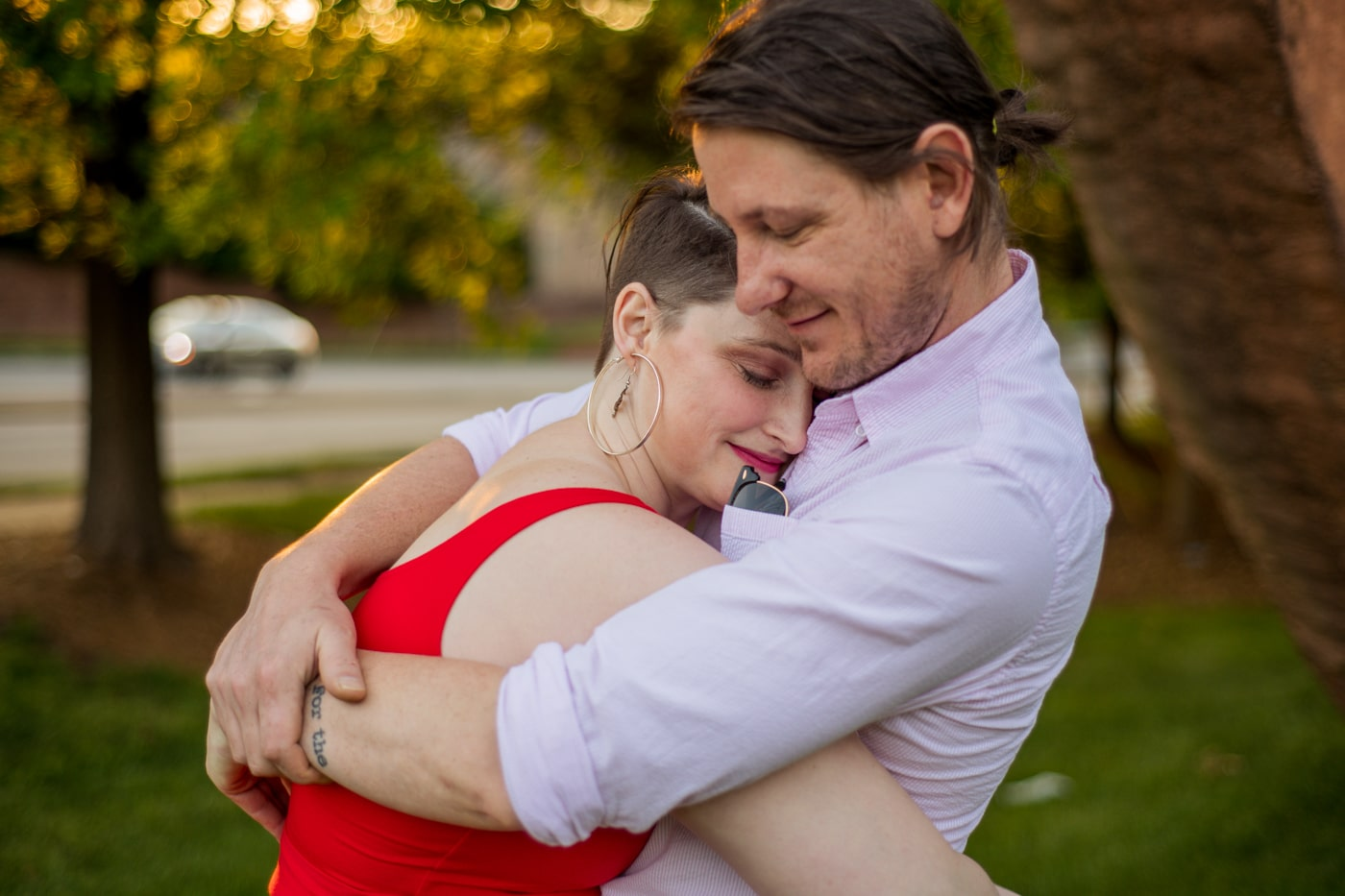 engaged couple hugs during NC engagement photos in Charlotte