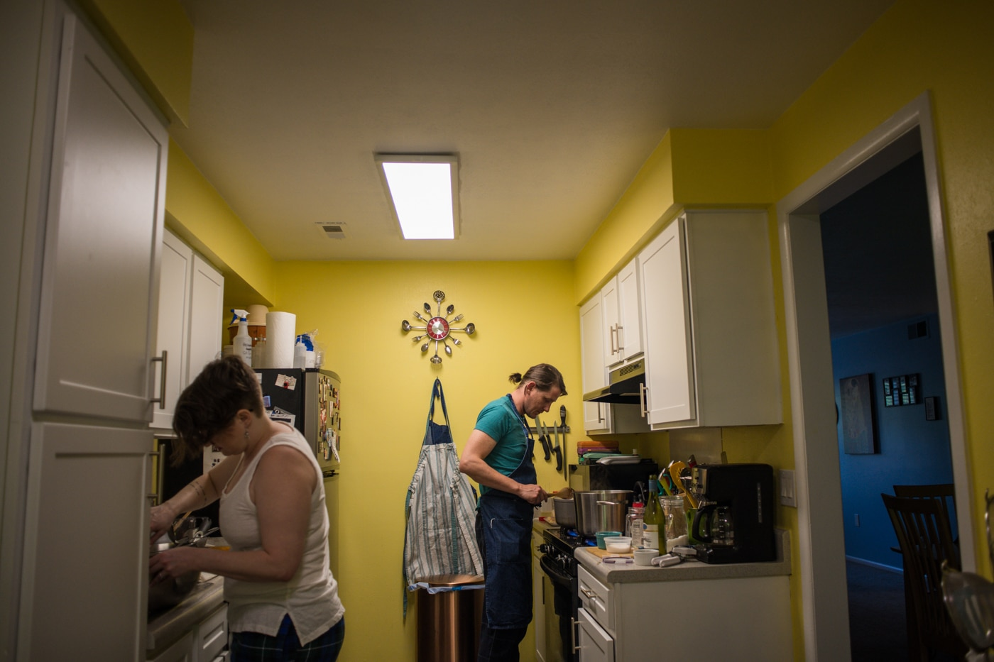 engaged couple cooks dinner in kitchen at home for engagement session