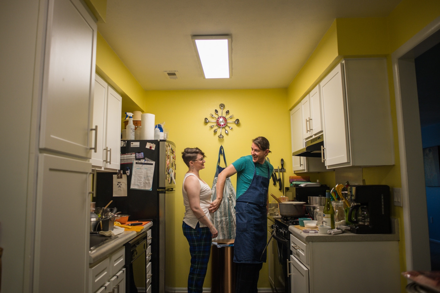 engagement portraits for couple cooking at home