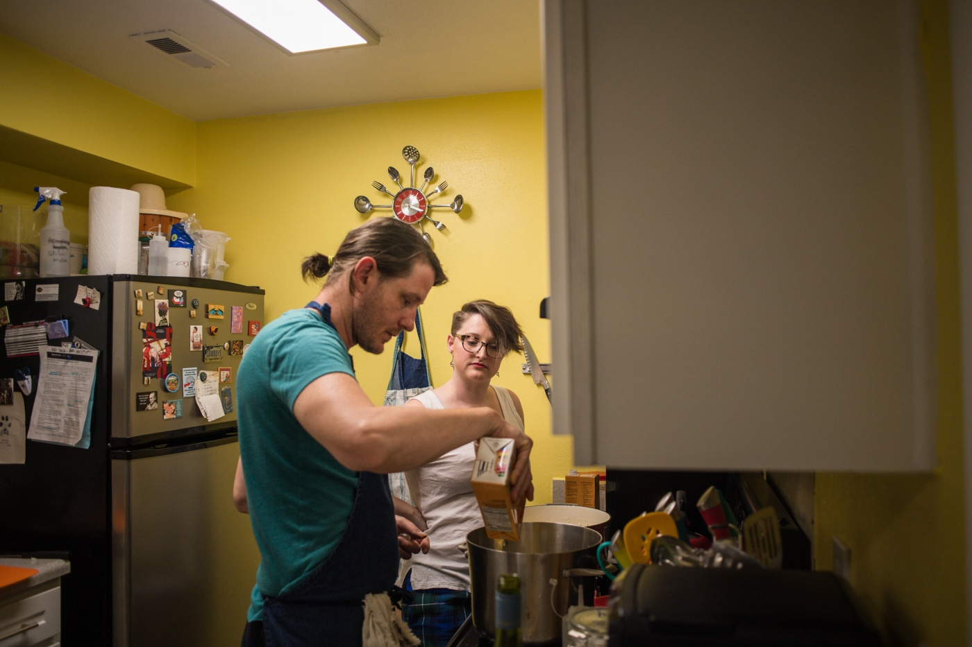 in-home engagement session with couple cooking