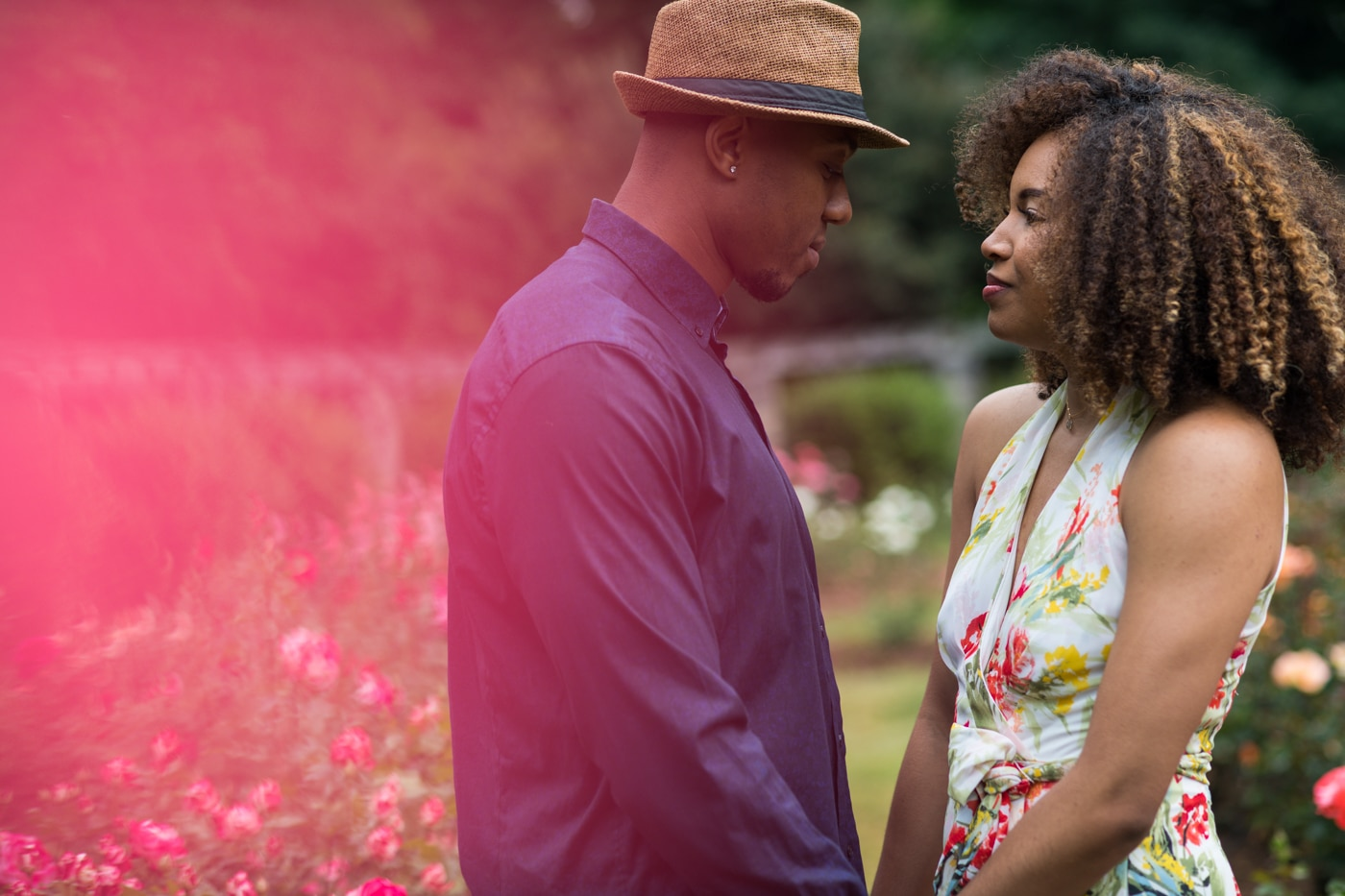 couple looks at each other during portraits in Raleigh NC