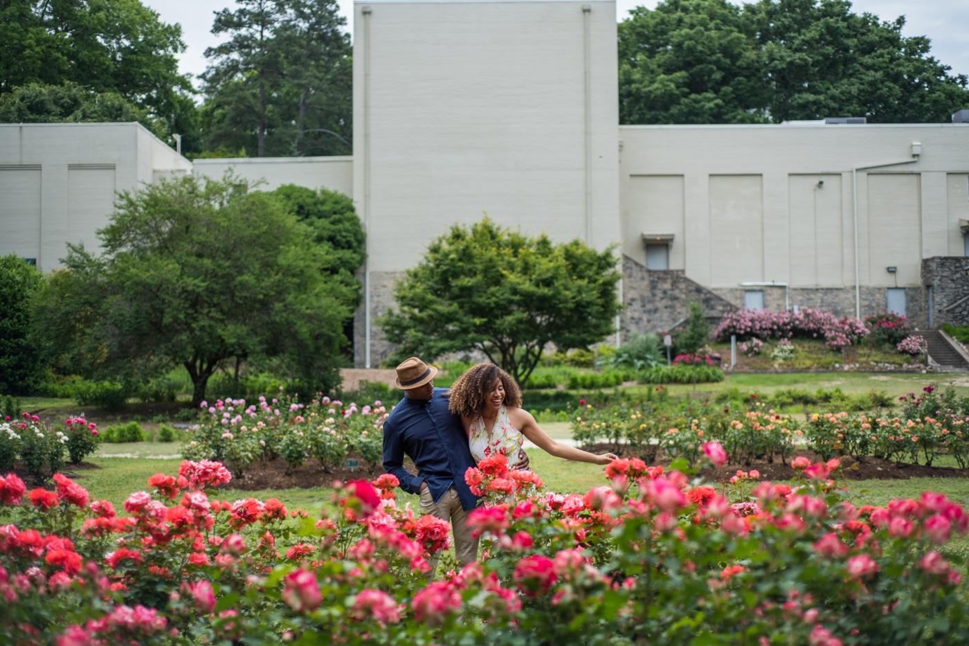 couple walks through Raleigh Rose Garden together