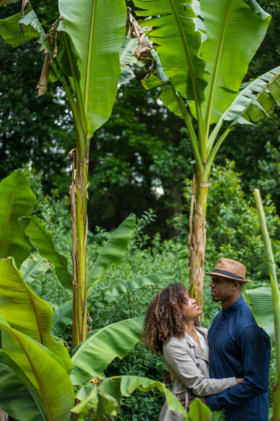 portraits with tall palm trees in Raleigh Rose Garden