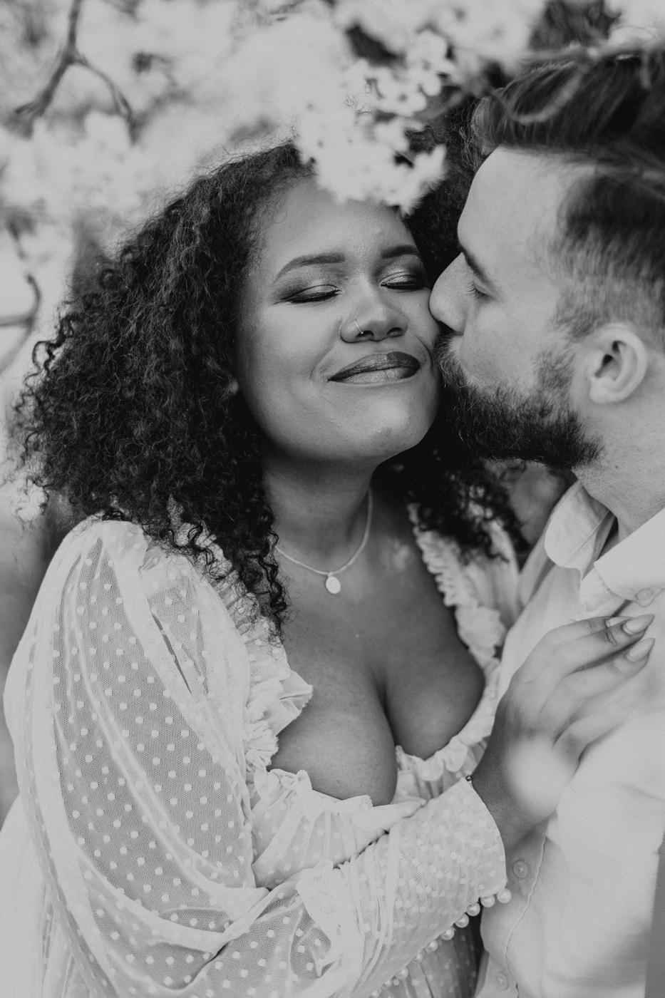 groom kisses bride's cheek during elopement portraits in Georgia