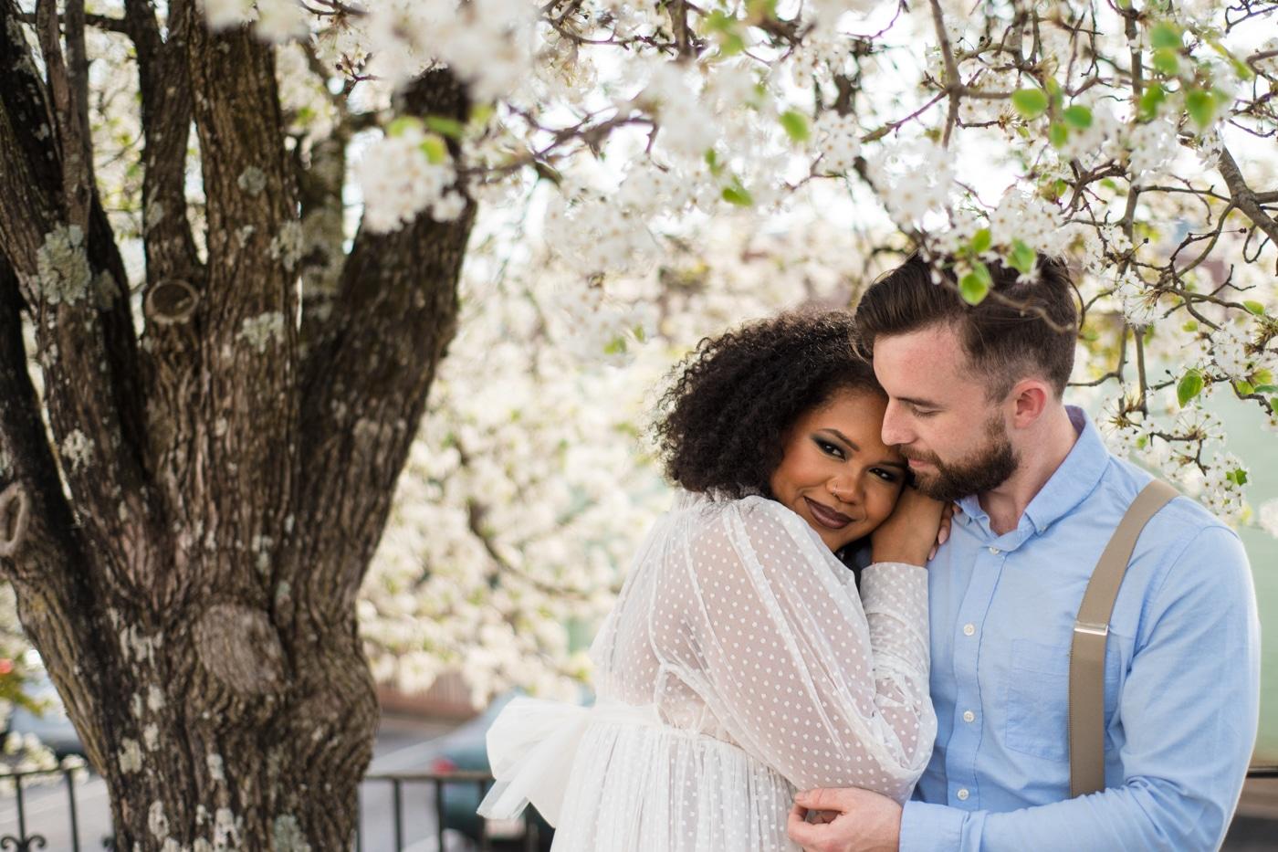 bride snuggles into groom's shoulder in Athens GA