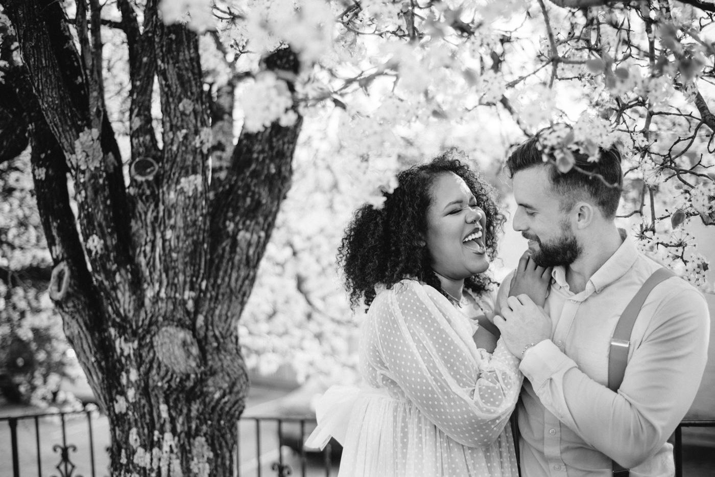 newlyweds smile together under spring tree in Athens GA