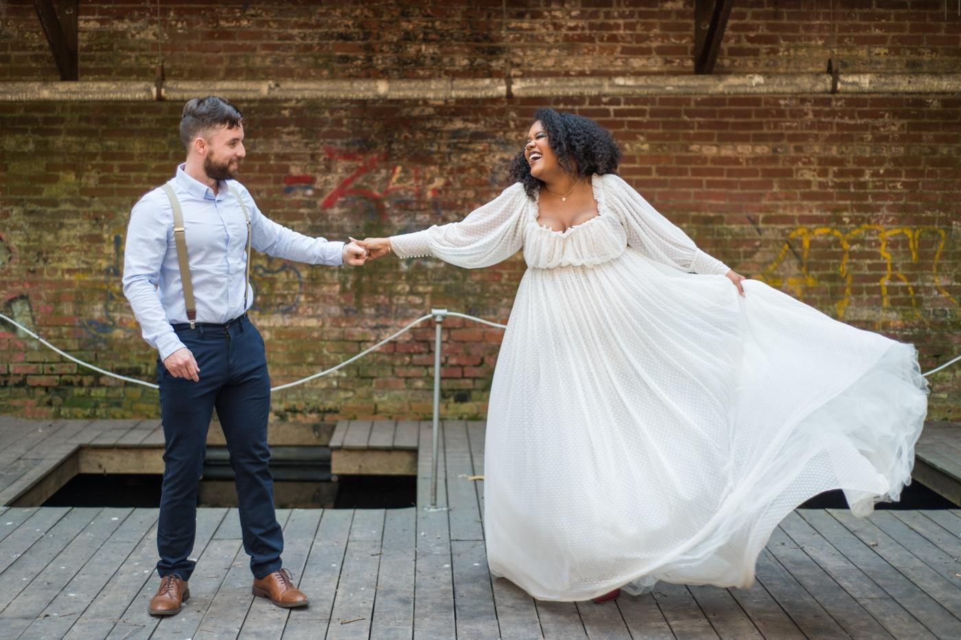 bride twirls wedding dress on dock at the Tree Room Athens