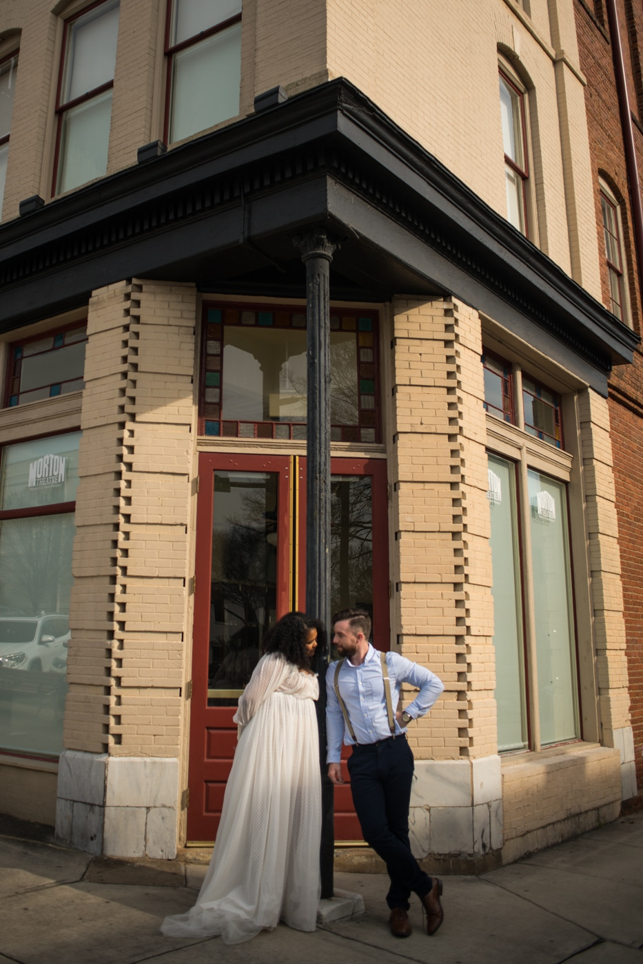 married couple poses outside building in Athens GA