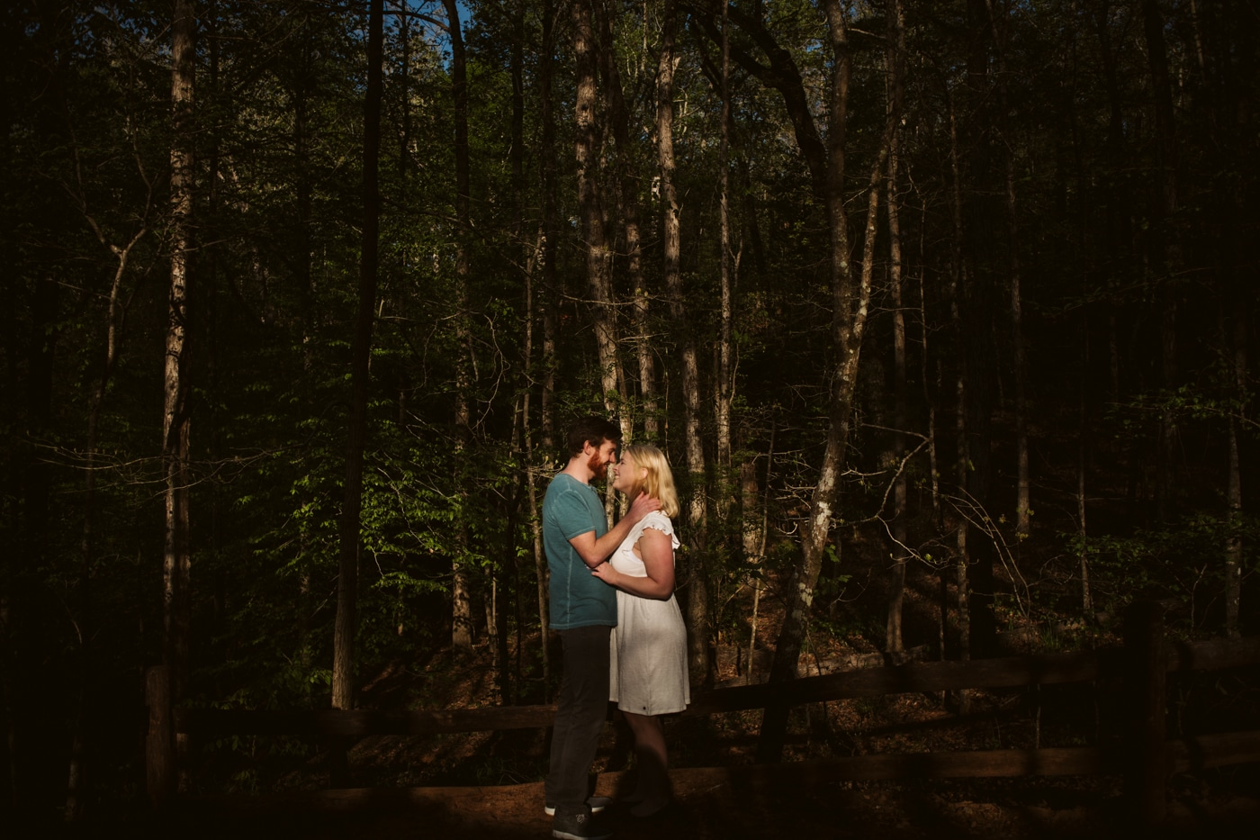 bride and groom kiss in dark woods of Providence Canyon