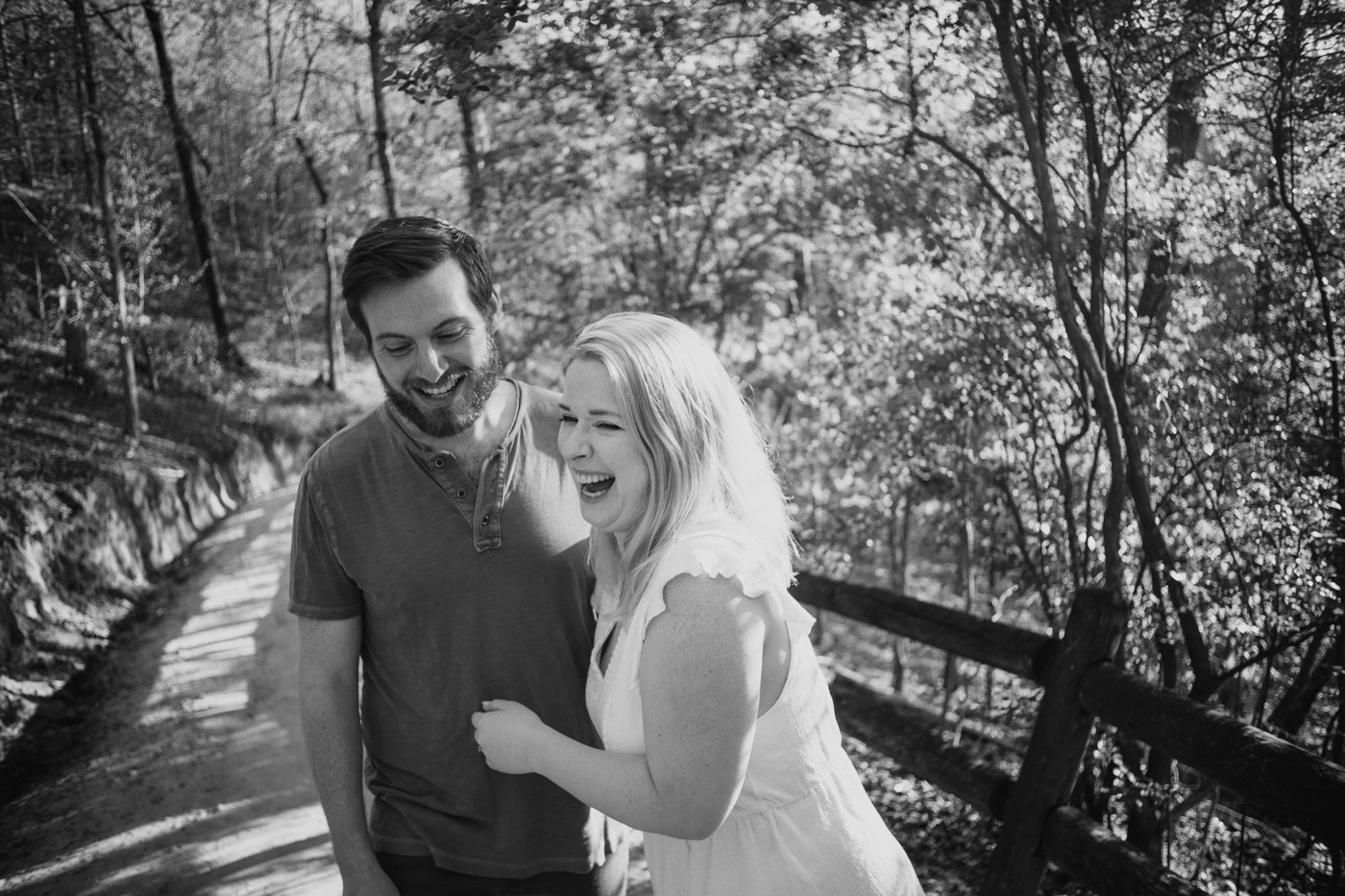 bride laughs while hugging groom on path in Providence Canyon