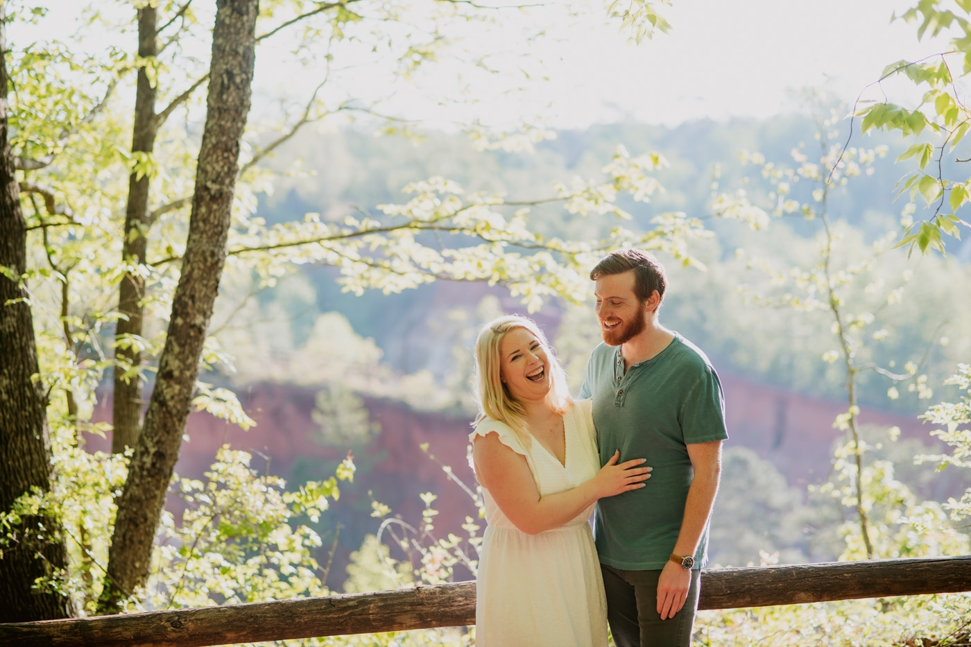 bride and groom laugh together on top of Providence Canyon