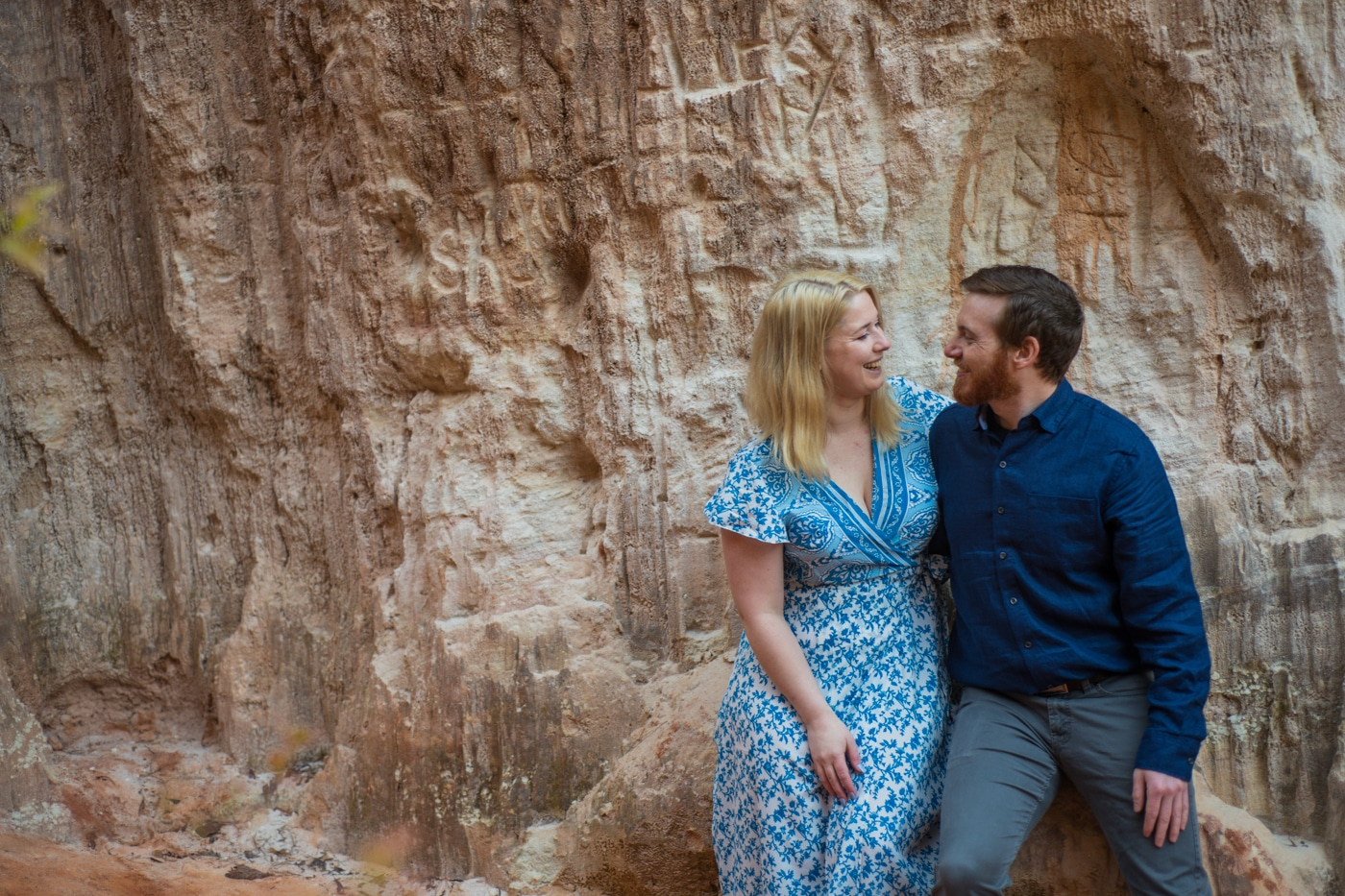 bride sits next to fiancee in Providence Canyon