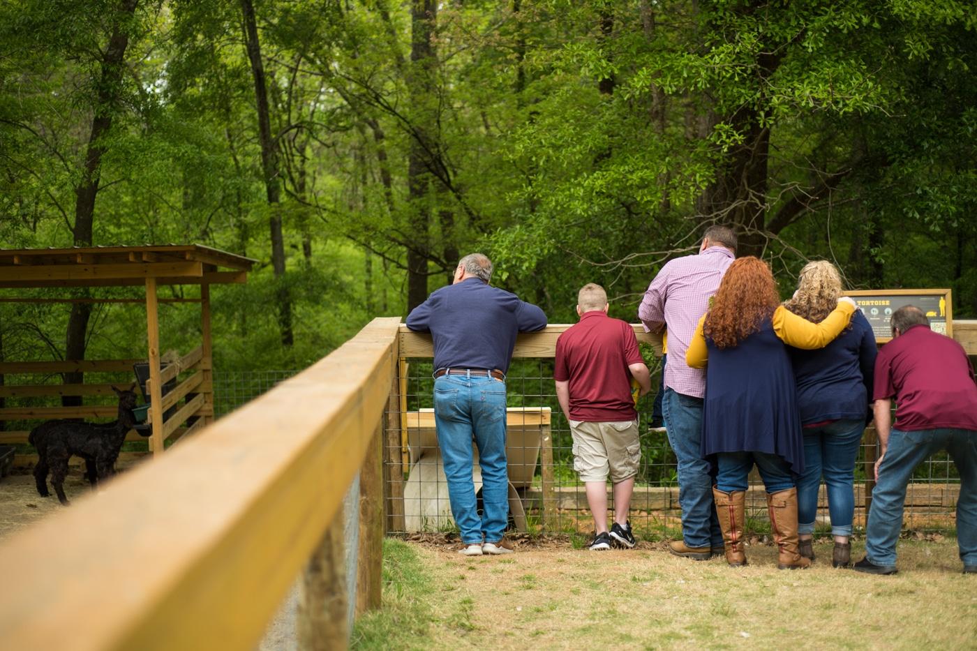 family looks at animals on wildlife preserve in Georgia