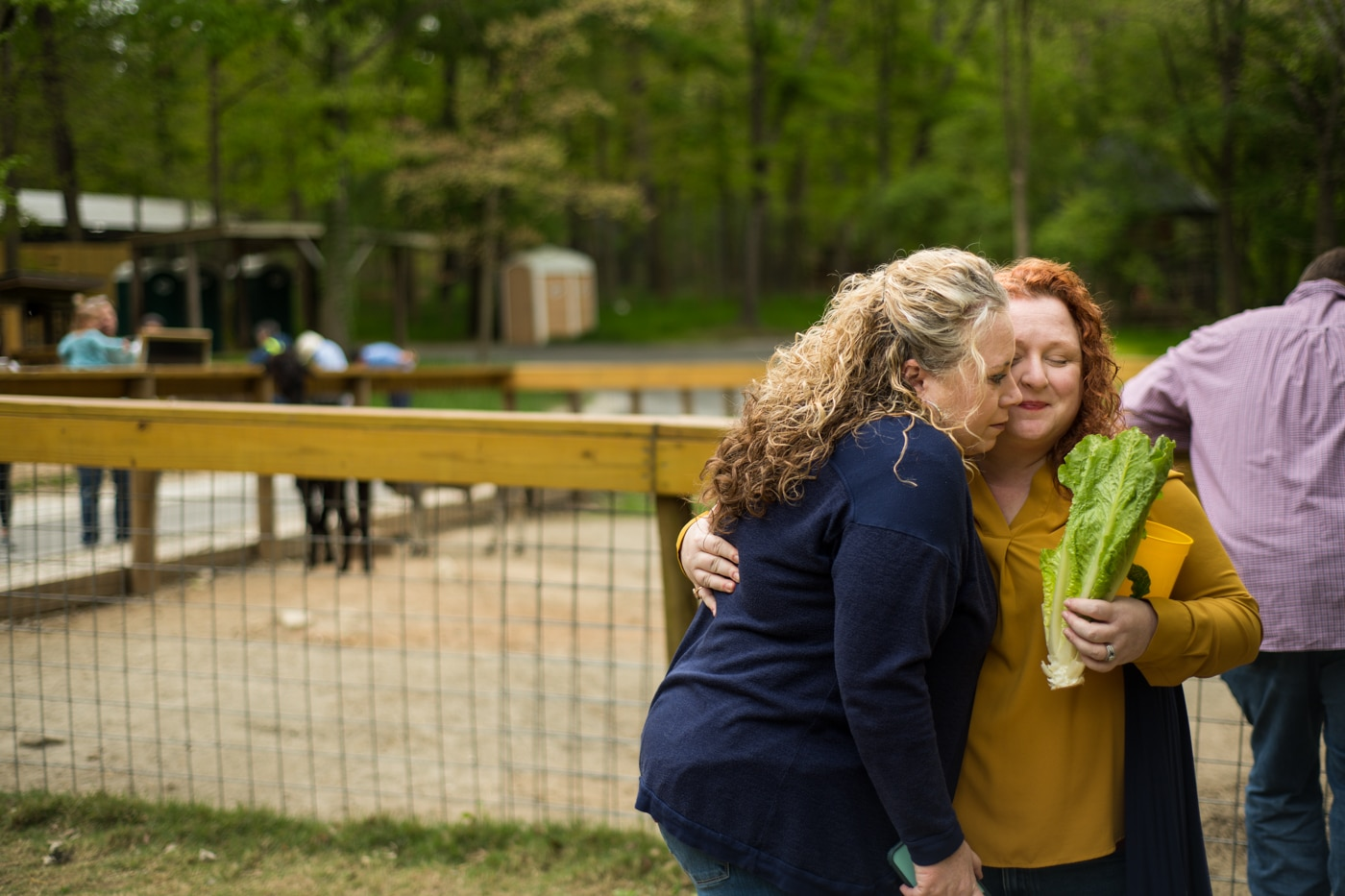 sisters hug during family portraits at the Yellow River Wildlife Sanctuary