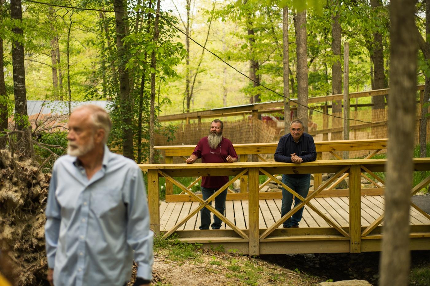 guys stand on bridge in Atlanta