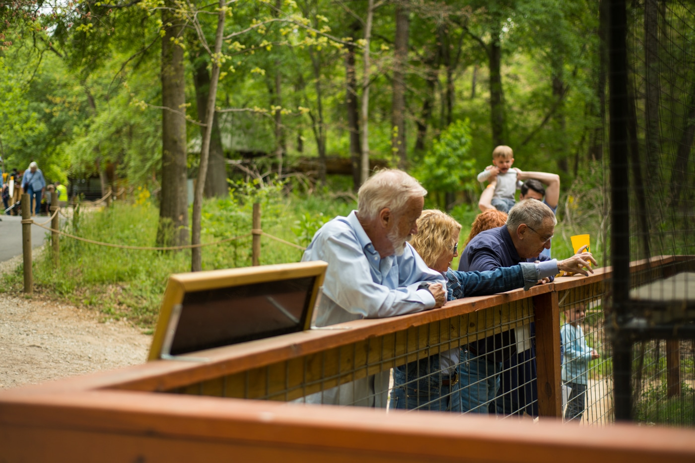 grandparents look over railing at Yellow River Wildlife Sanctuary