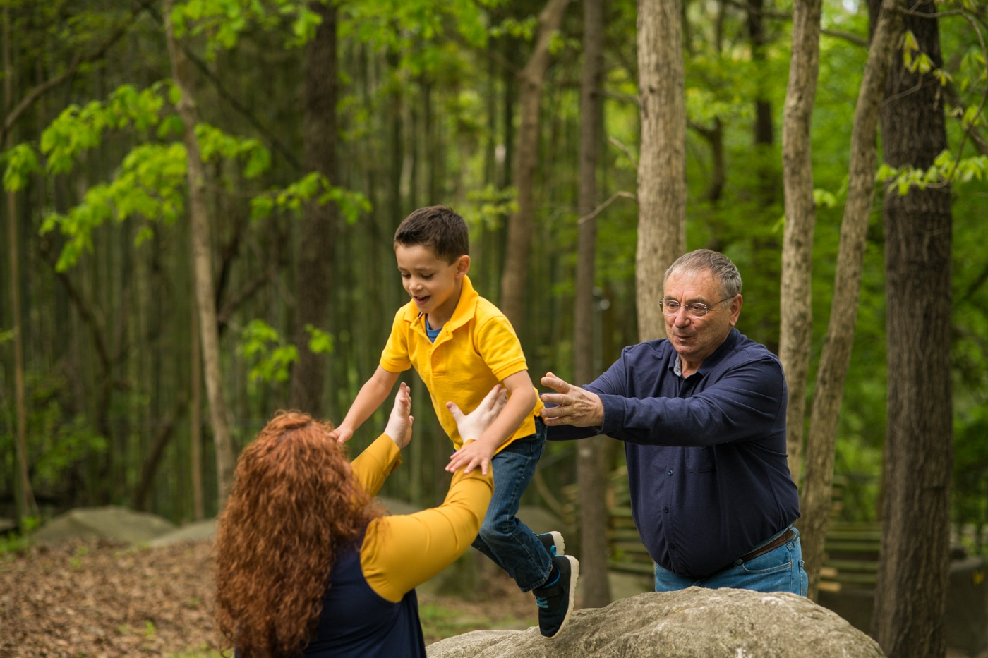 parents play with son on rocks during Atlanta family photos