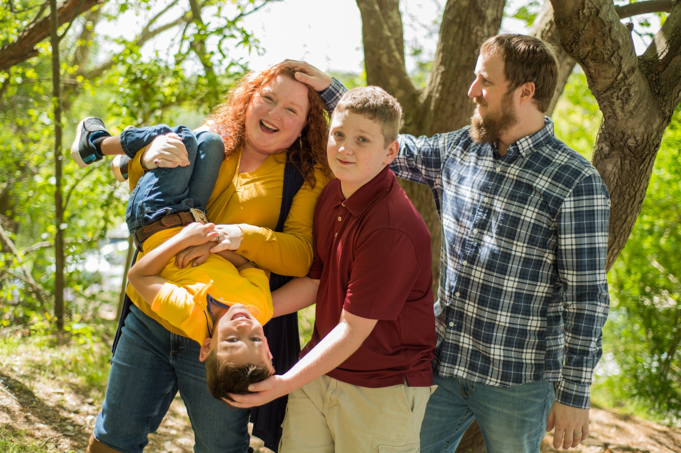 family laughs together during Yellow River Wildlife Sanctuary Family Session