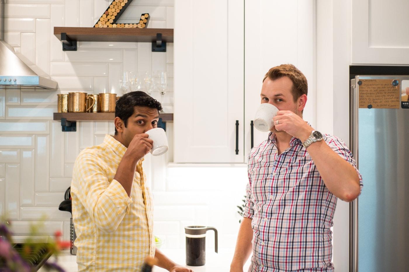 Engaged queer couple drinking coffee in their kitchen in Atlanta Georgia Raven Shutley Studios