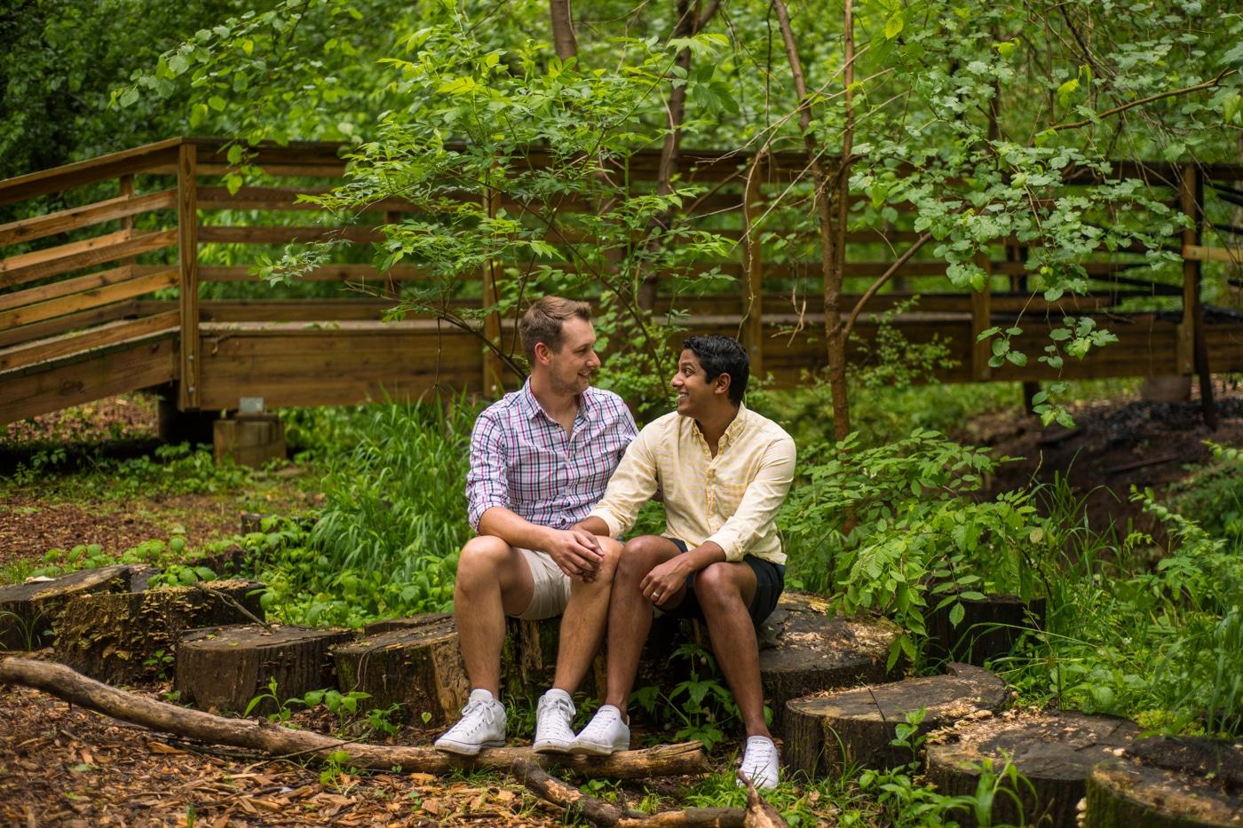 Engaged men holding hands an sitting in their backyard at Atlanta GA home Raven Shutley Studios