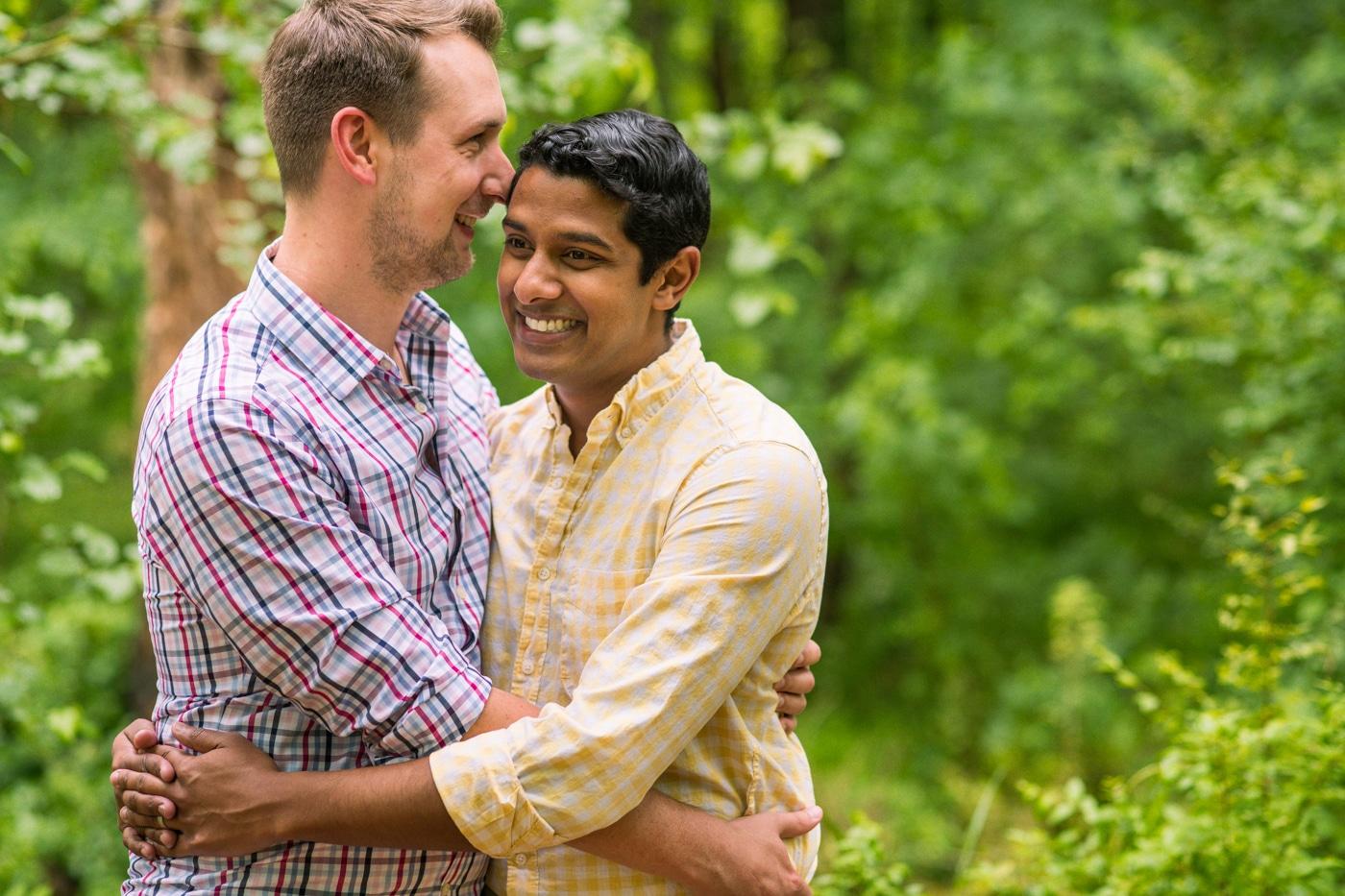 LGBTQ future spouse hugs fiance smiling outside in Atlanta GA Raven Shutley Save the Date Photoshoot