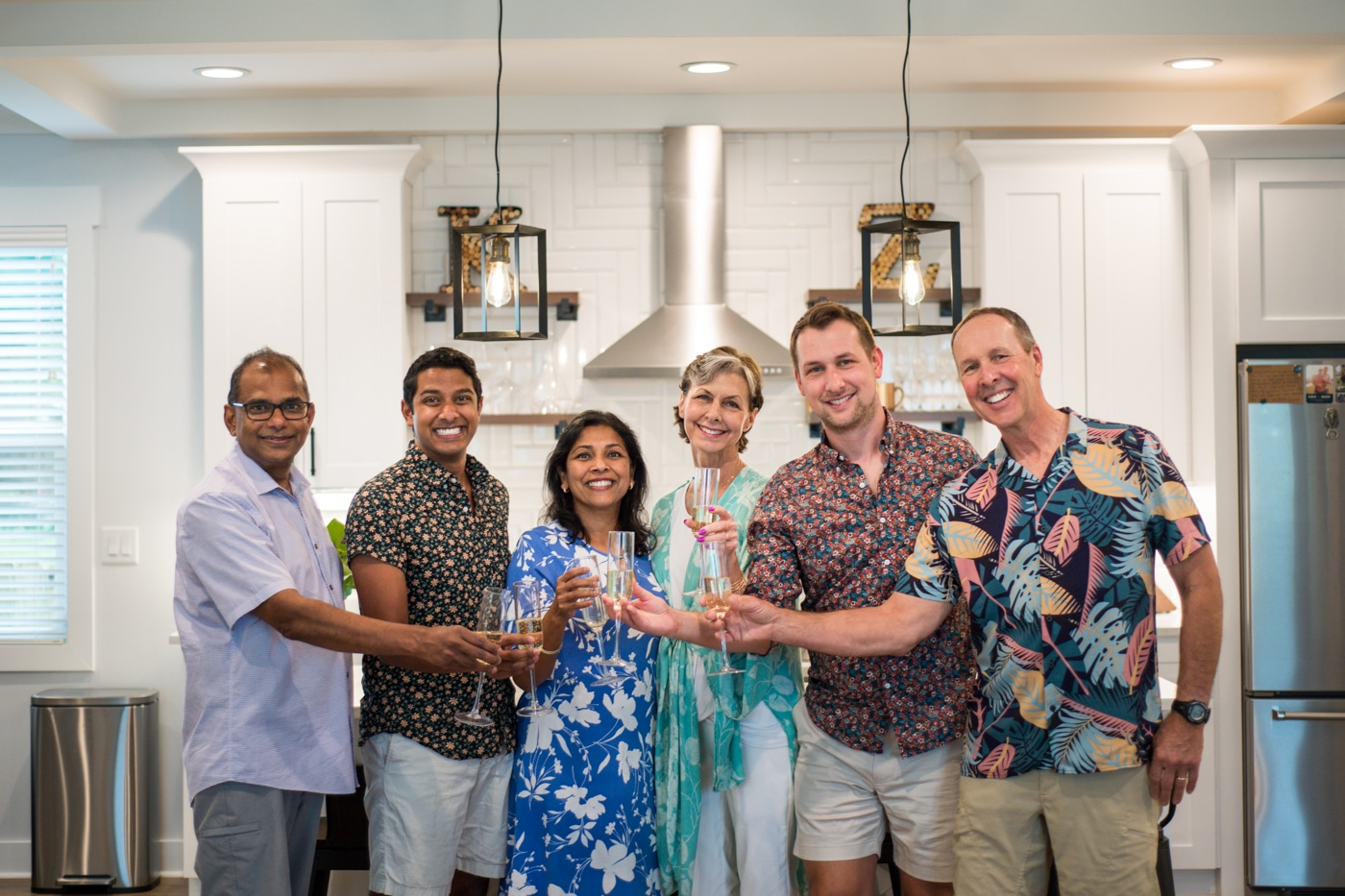 LGBTQ engaged couple toasts their engagement with their parents in Atlanta GA Raven Shutley Studios