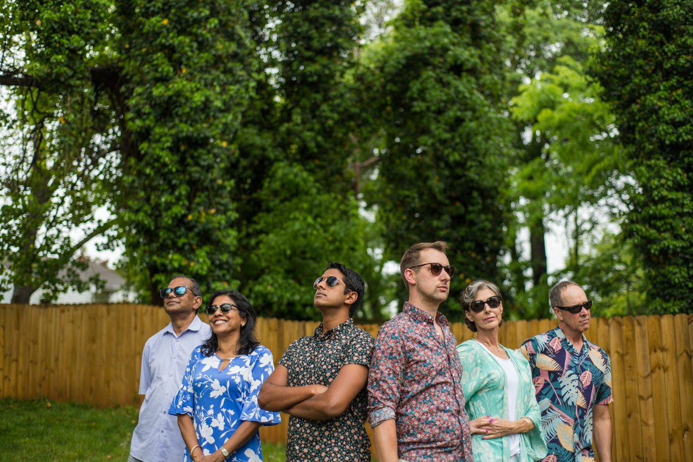 Engaged couple posing in sunglasses with their parents in their backyard in Atlanta GA Raven Shutley