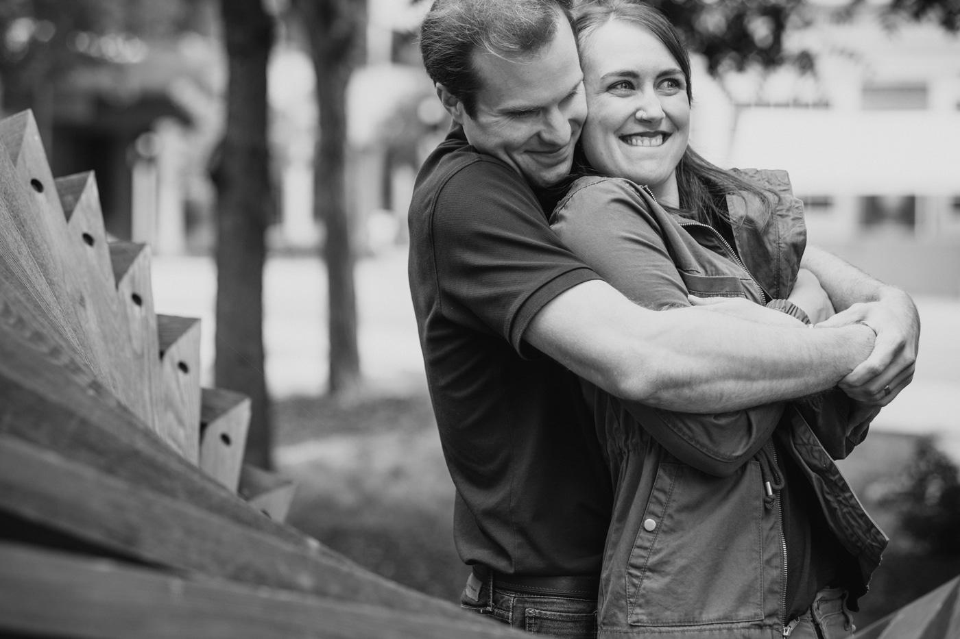 groom hugs bride during Durham engagement session