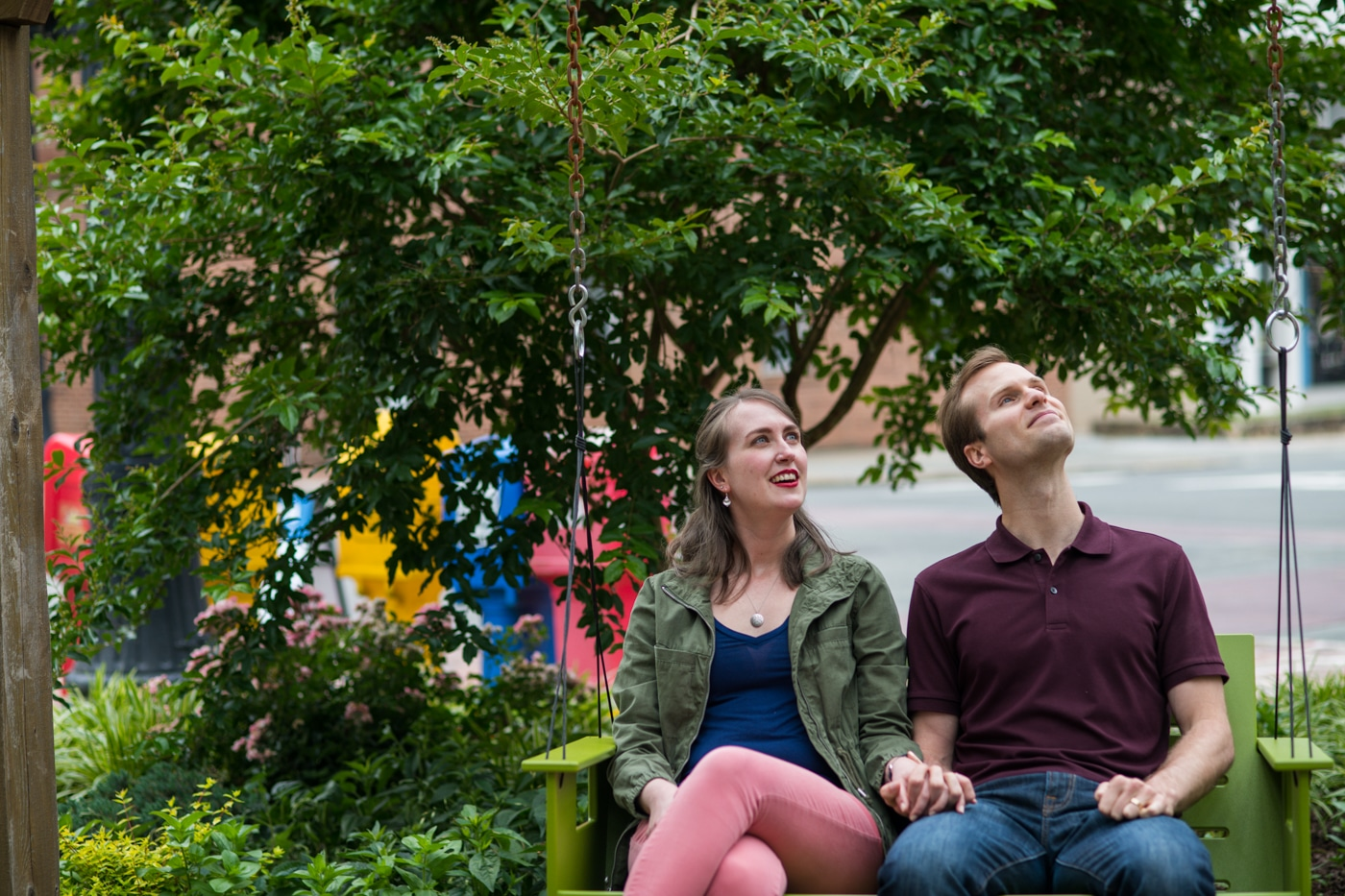 bride and groom sit looking at the sky during Durham engagement session