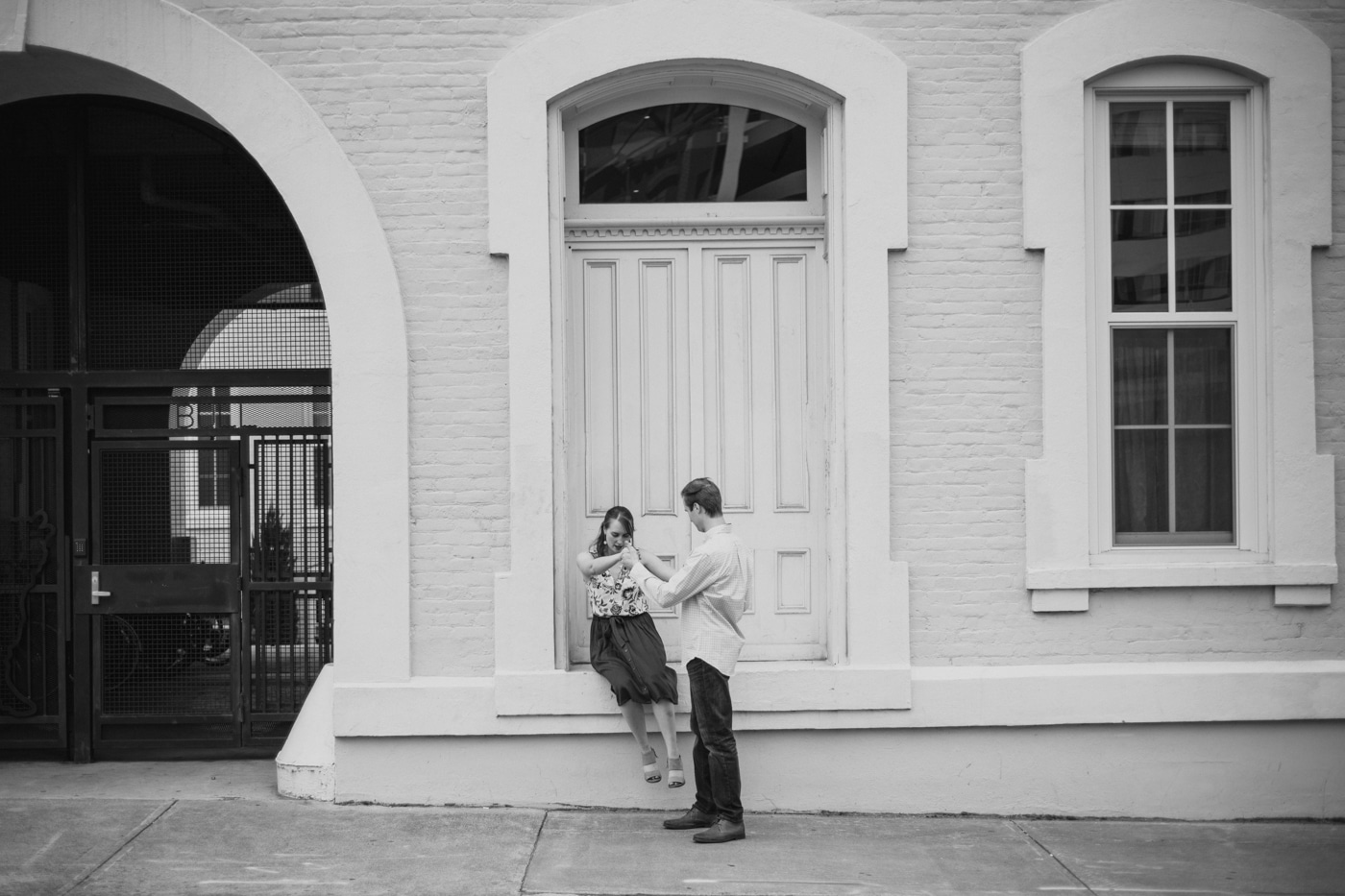 bride and groom hold hands outside Durham NC home