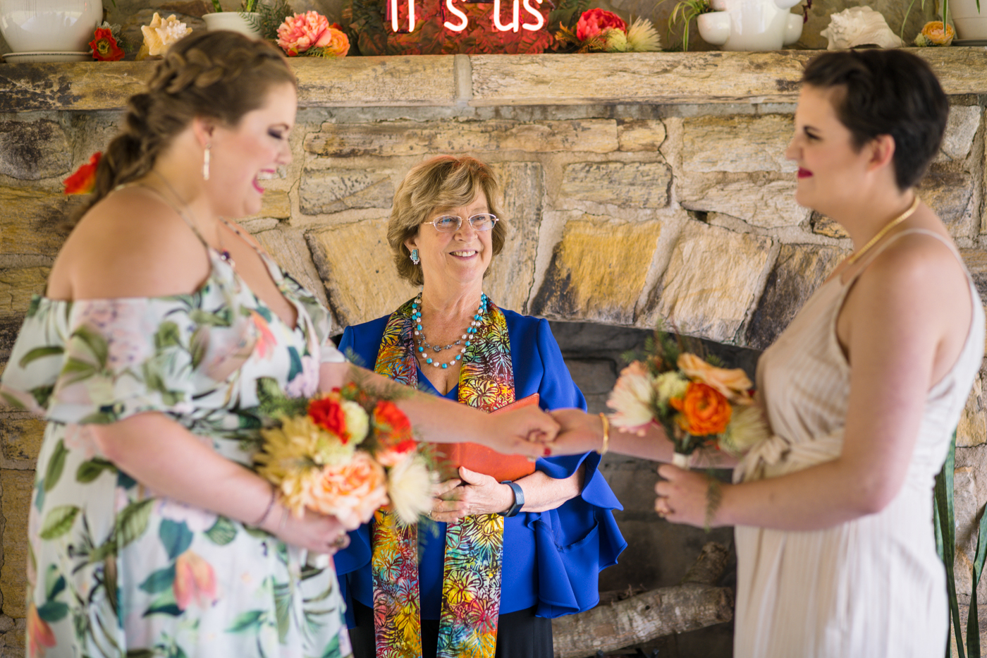 brides exchange vows during ceremony in Raleigh NC