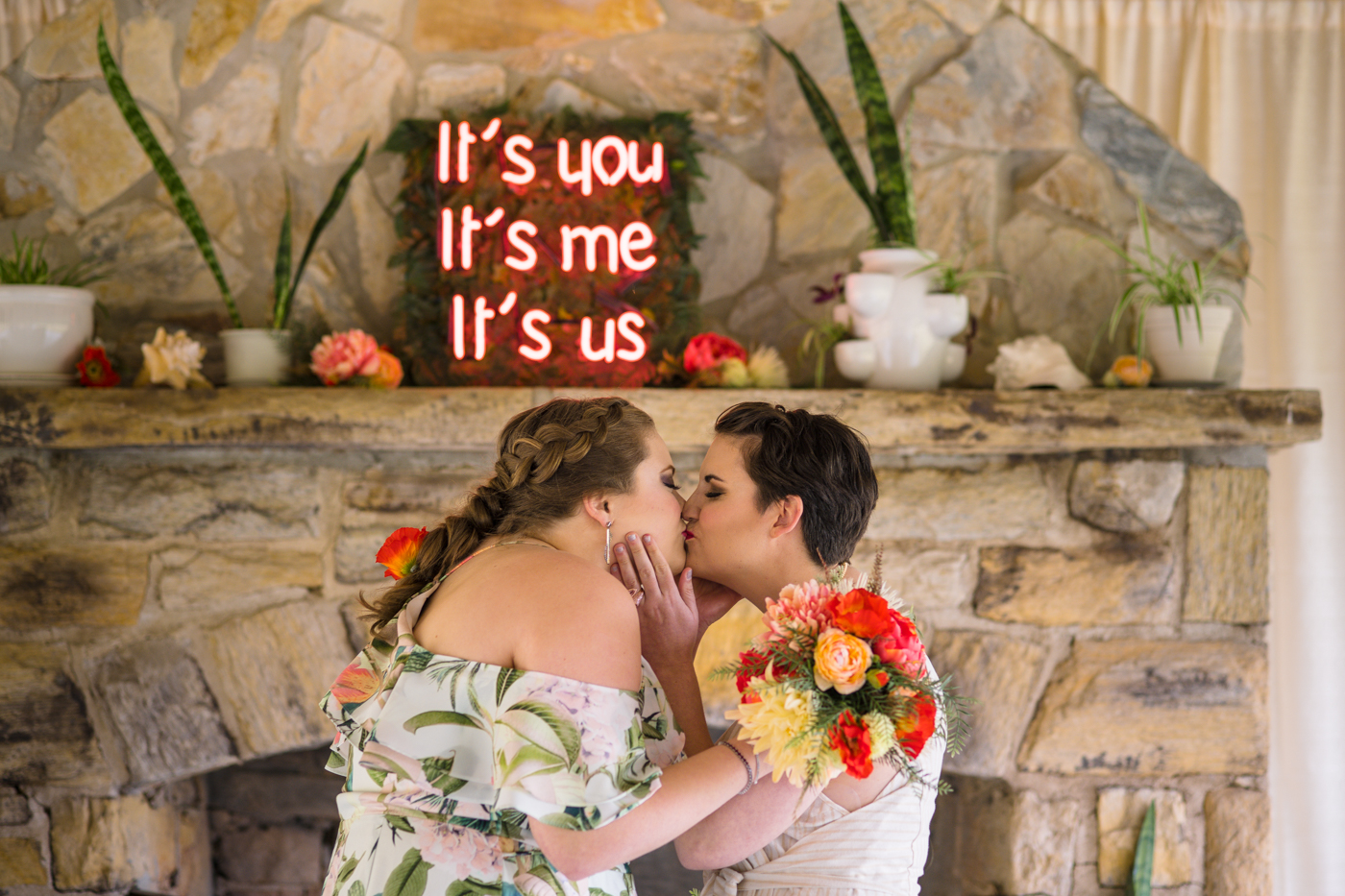 brides kiss during Green Wedding Guild styled shoot ceremony