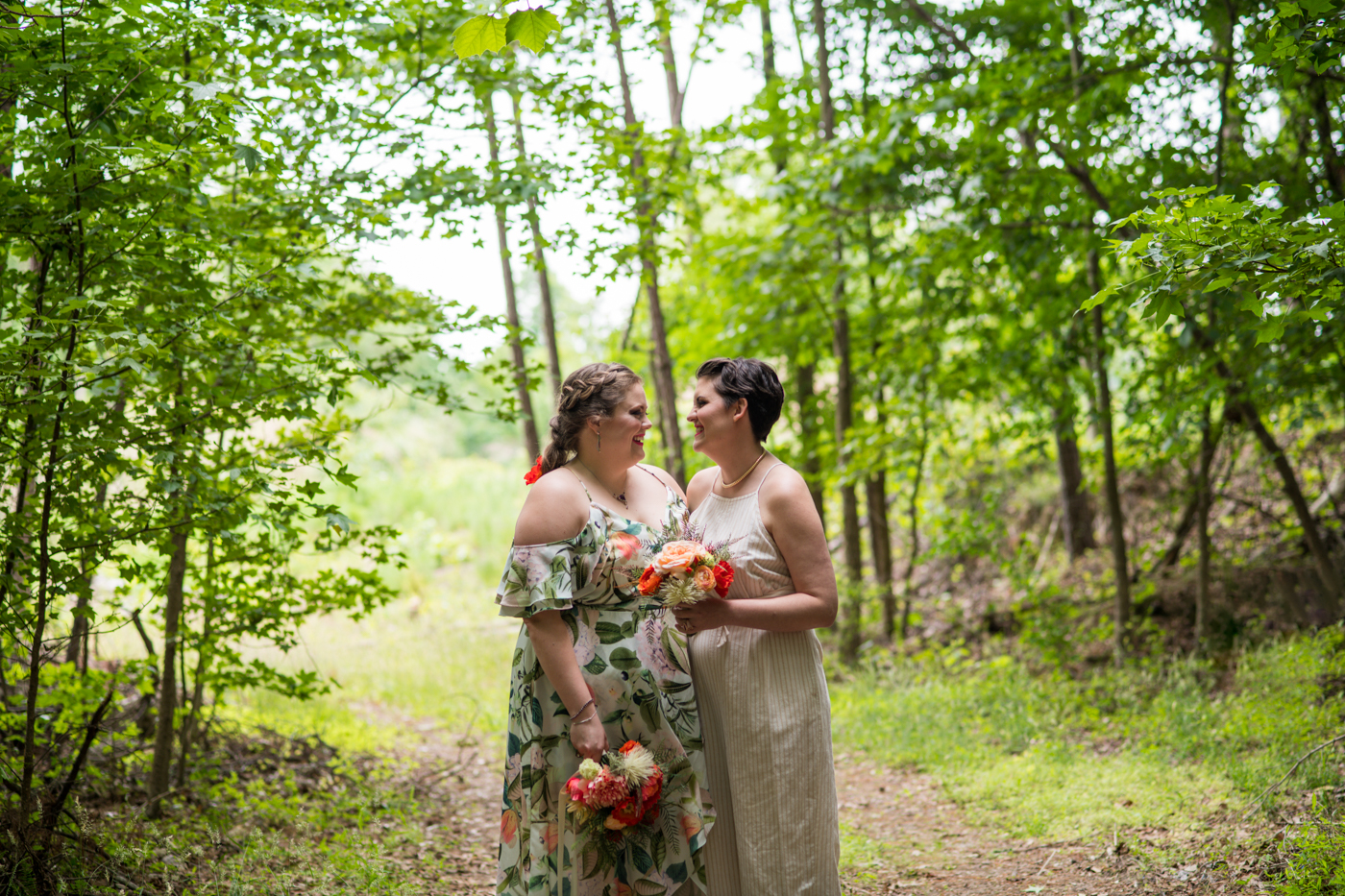 women pose on path during Green Wedding Guild styled shoot