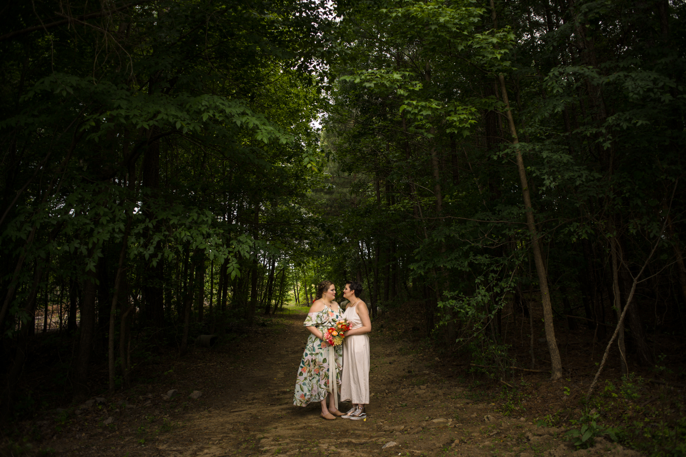 wedding portraits in woods of Raleigh NC park