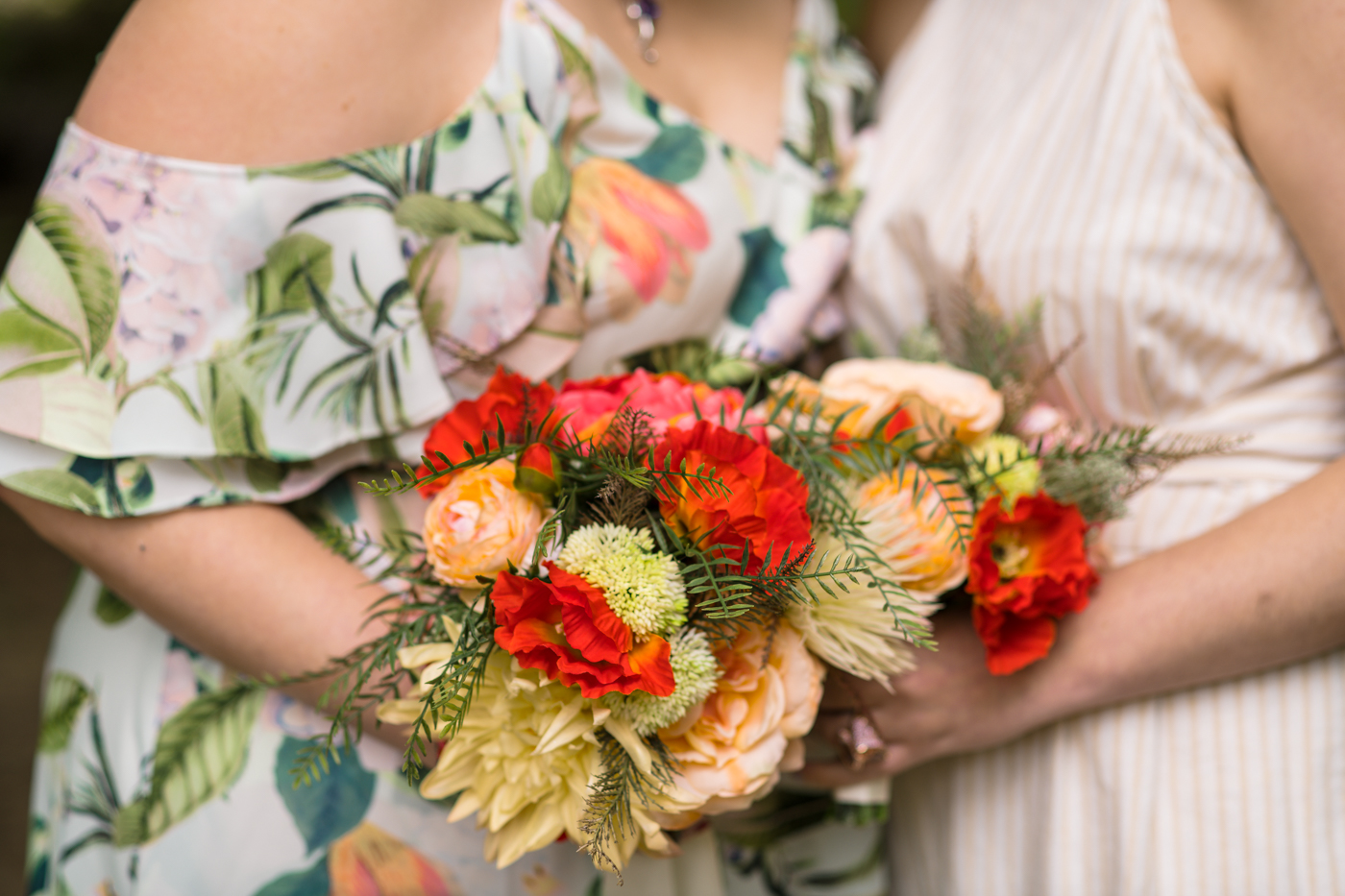 brides hold bright colored bouquets during Green Wedding Guild styled shoot