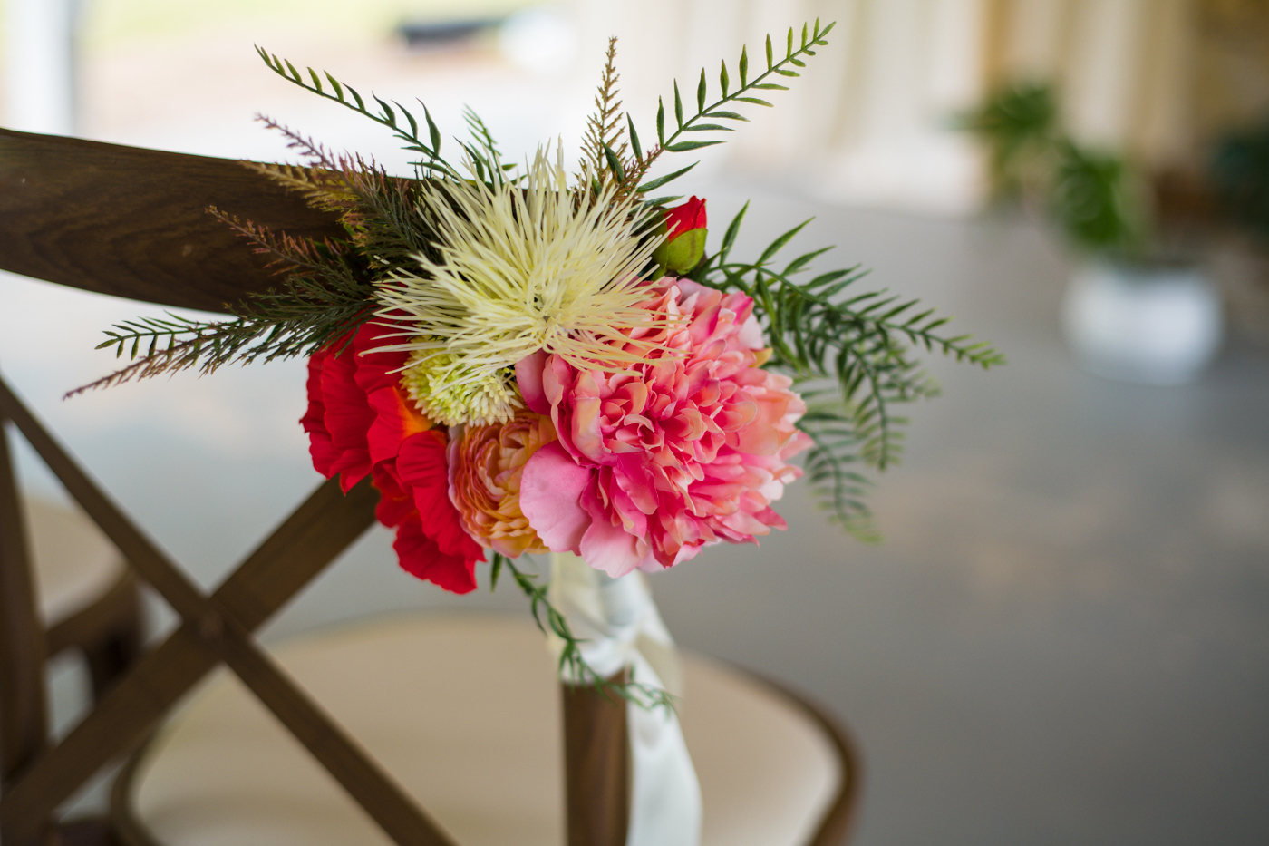 tropical flowers on ceremony chair