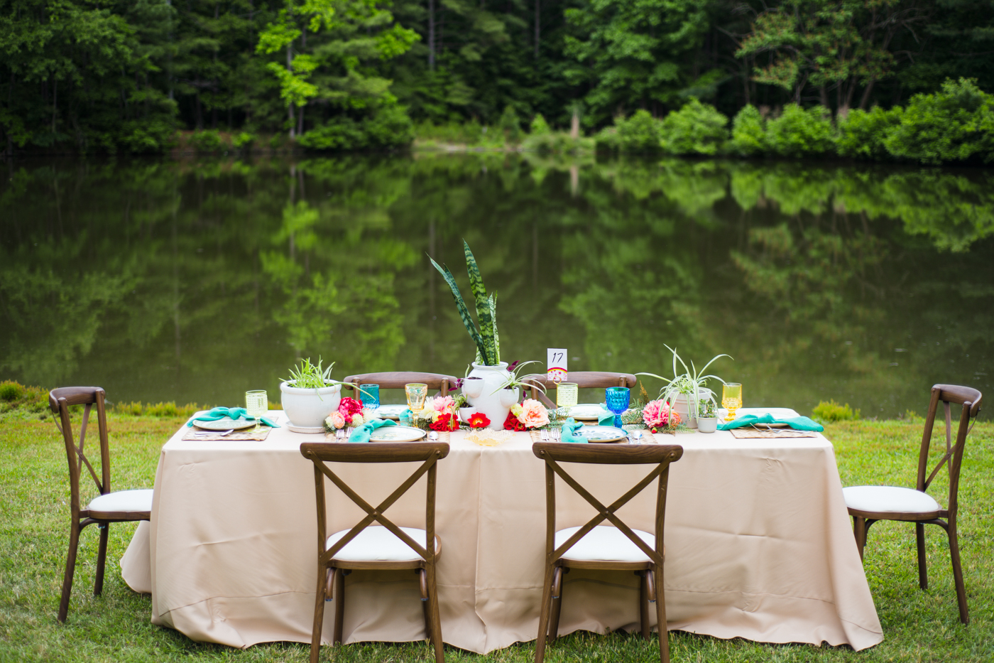 outdoor wedding reception with bright centerpieces in Raleigh NC