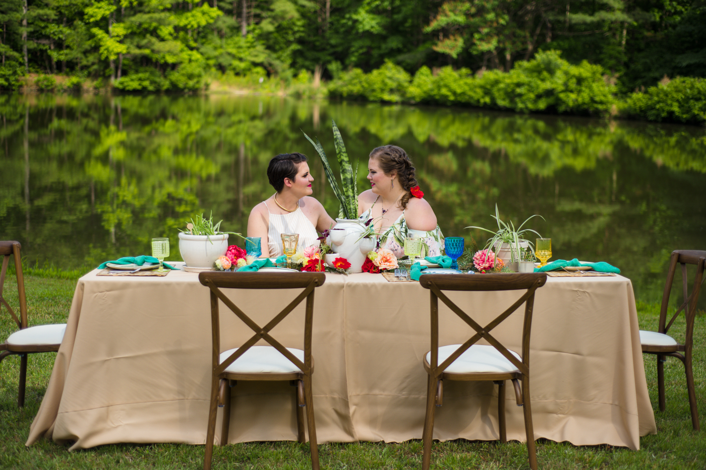 brides talk at reception table during Raleigh NC styled shoot
