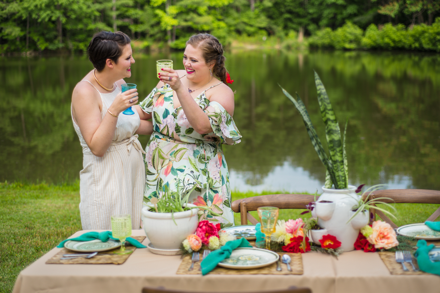 brides toast during outdoor reception at the Bill Scott Pavilion