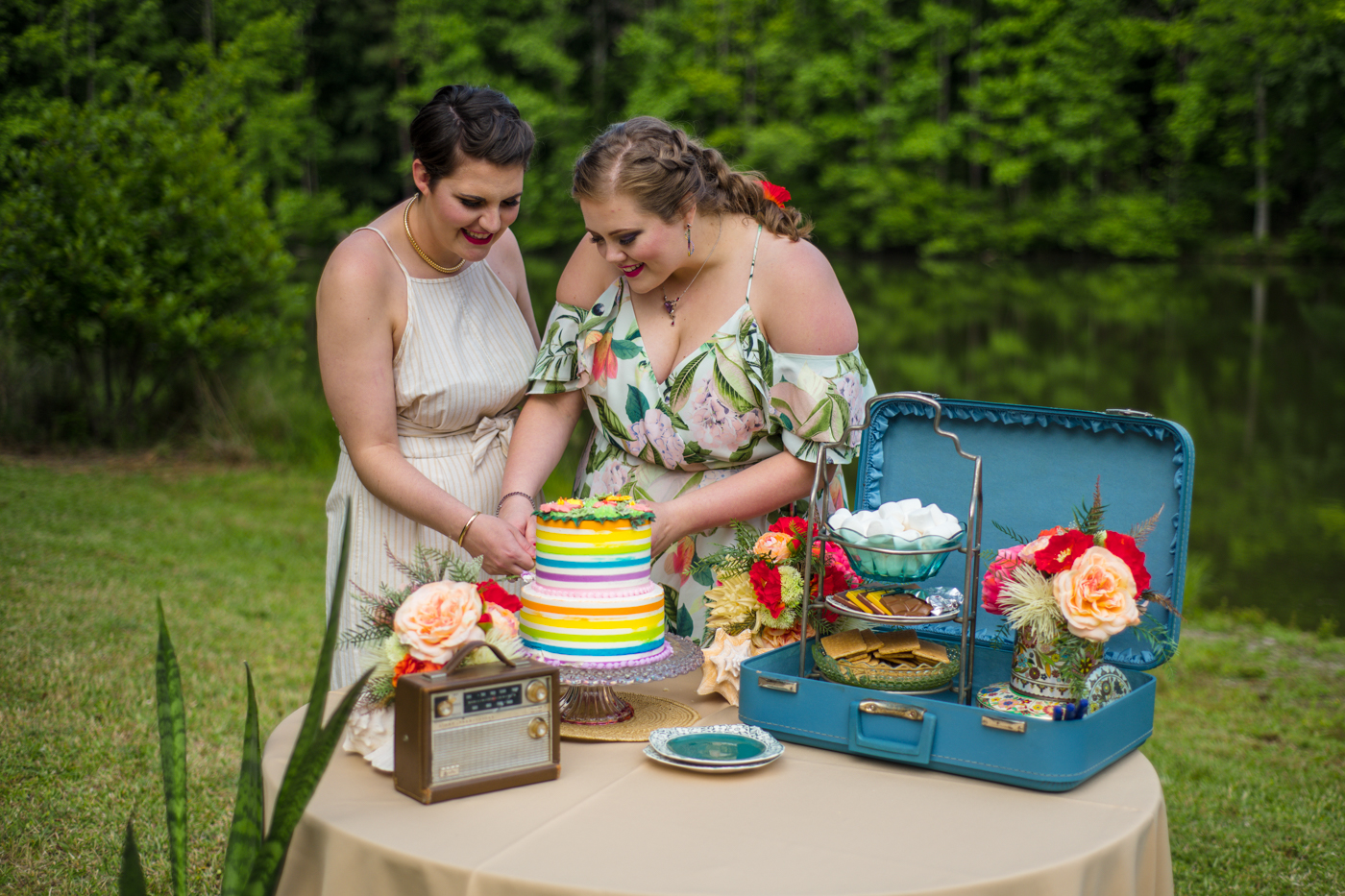 brides cut colorful wedding cake during NC styled shoot