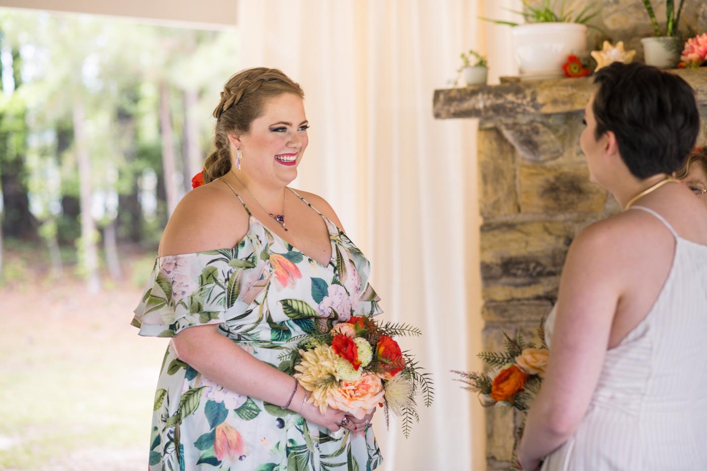 brides exchange vow during ceremony at Bill Scott Pavilion