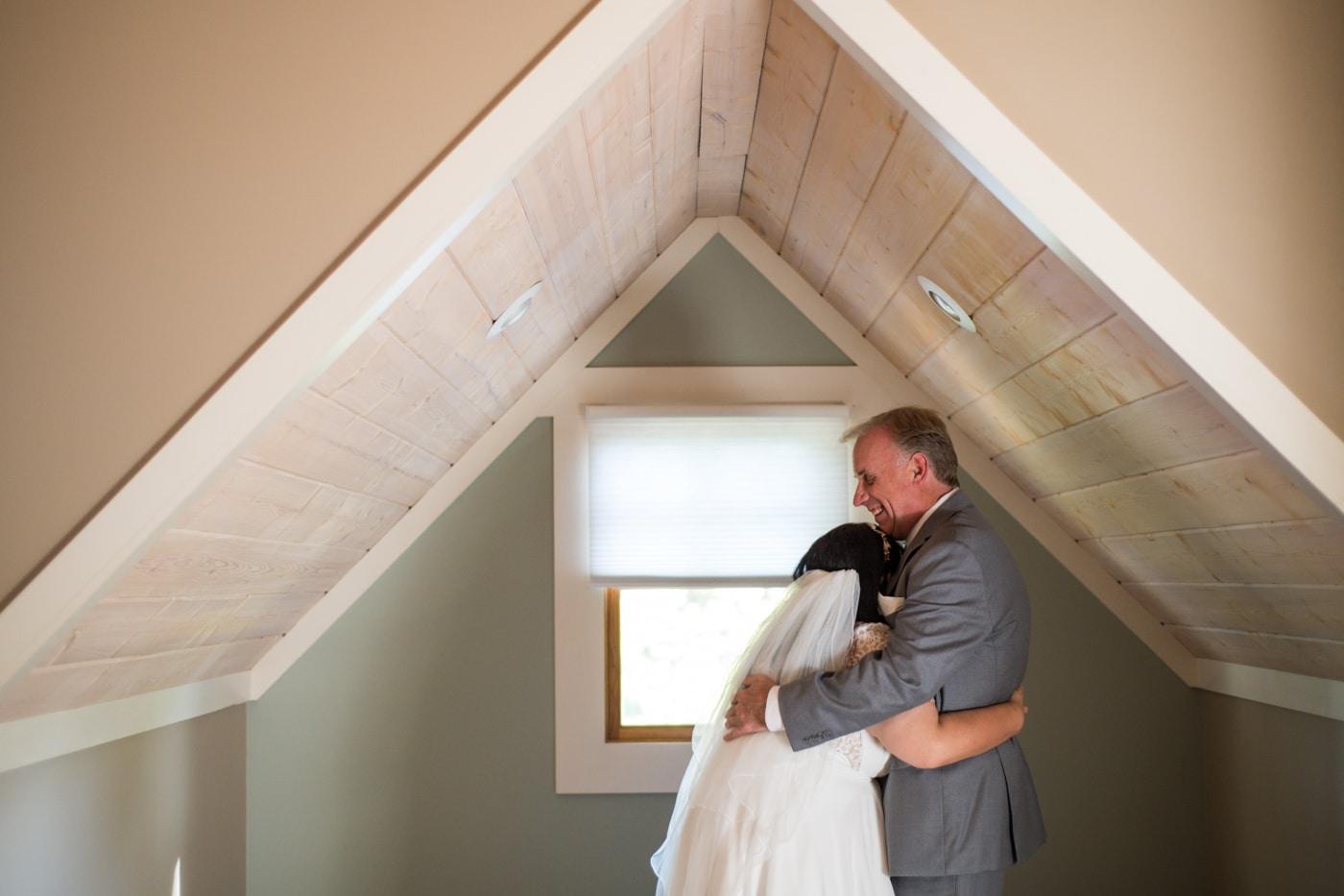 groom hugs bride during Lake Blue Ridge wedding portraits