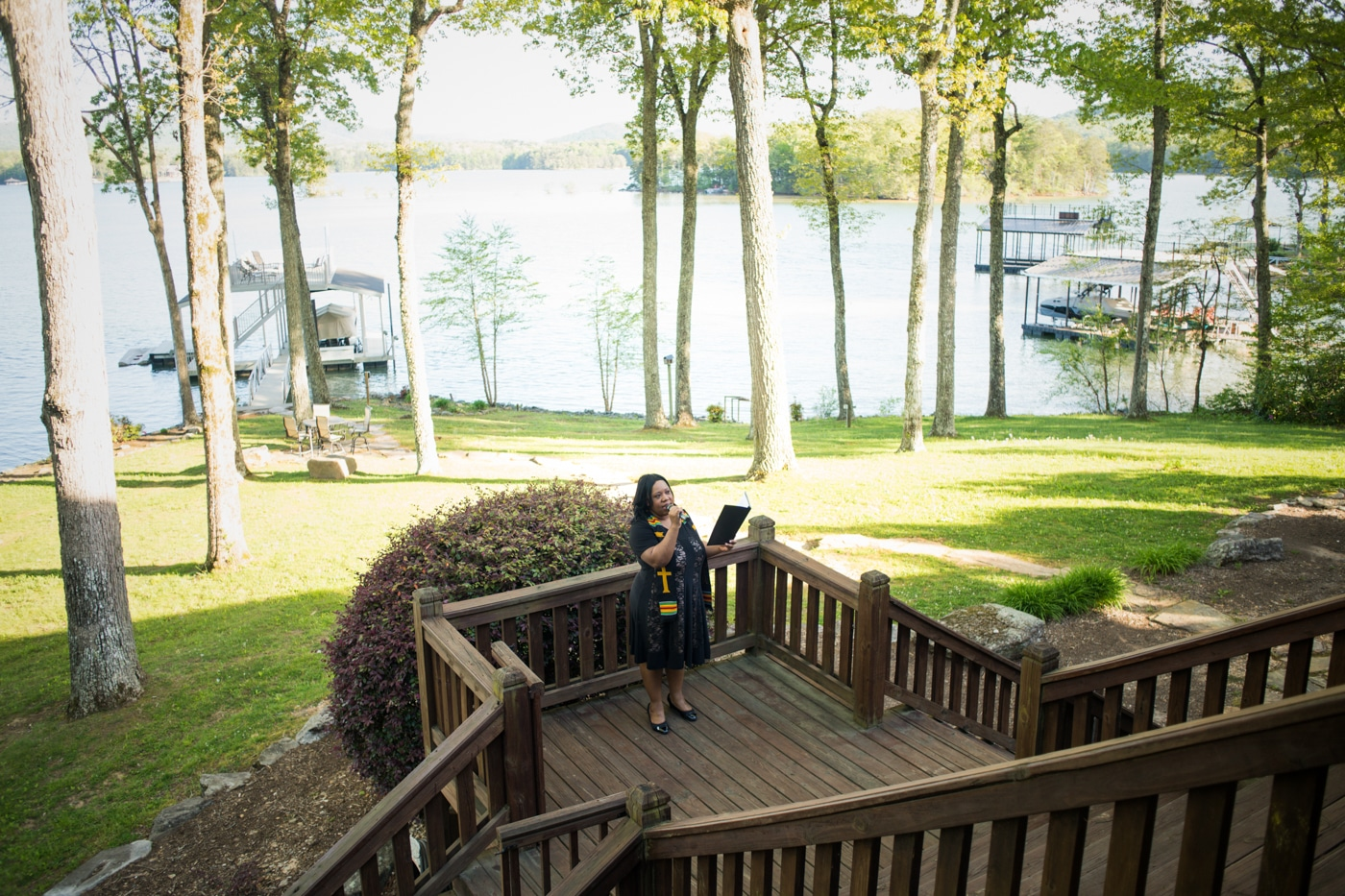 officiant welcomes guests to wedding ceremony