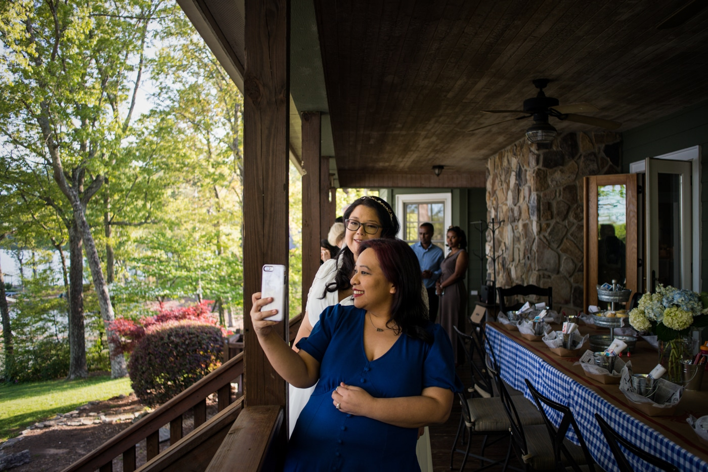 family takes a selfie with bride before wedding